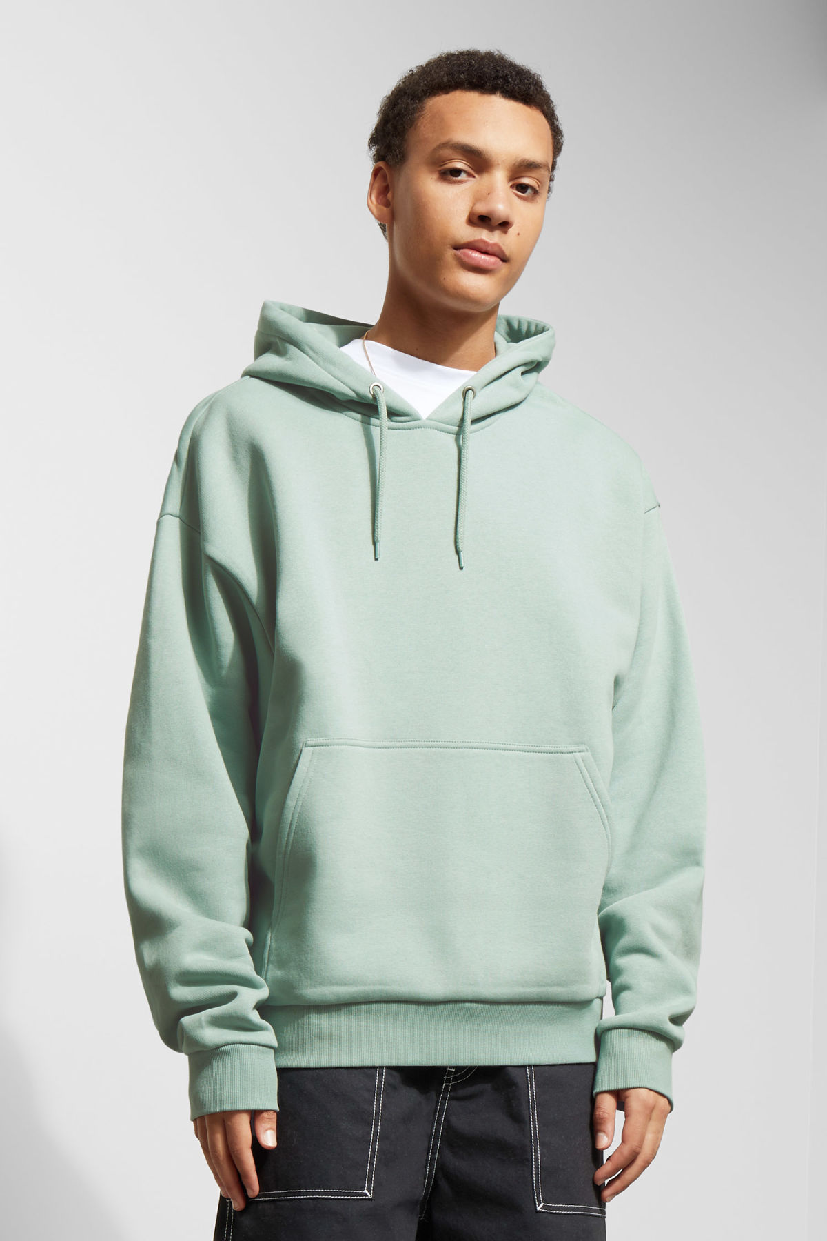 Model front image of Weekday big hawk hoodie in turquoise