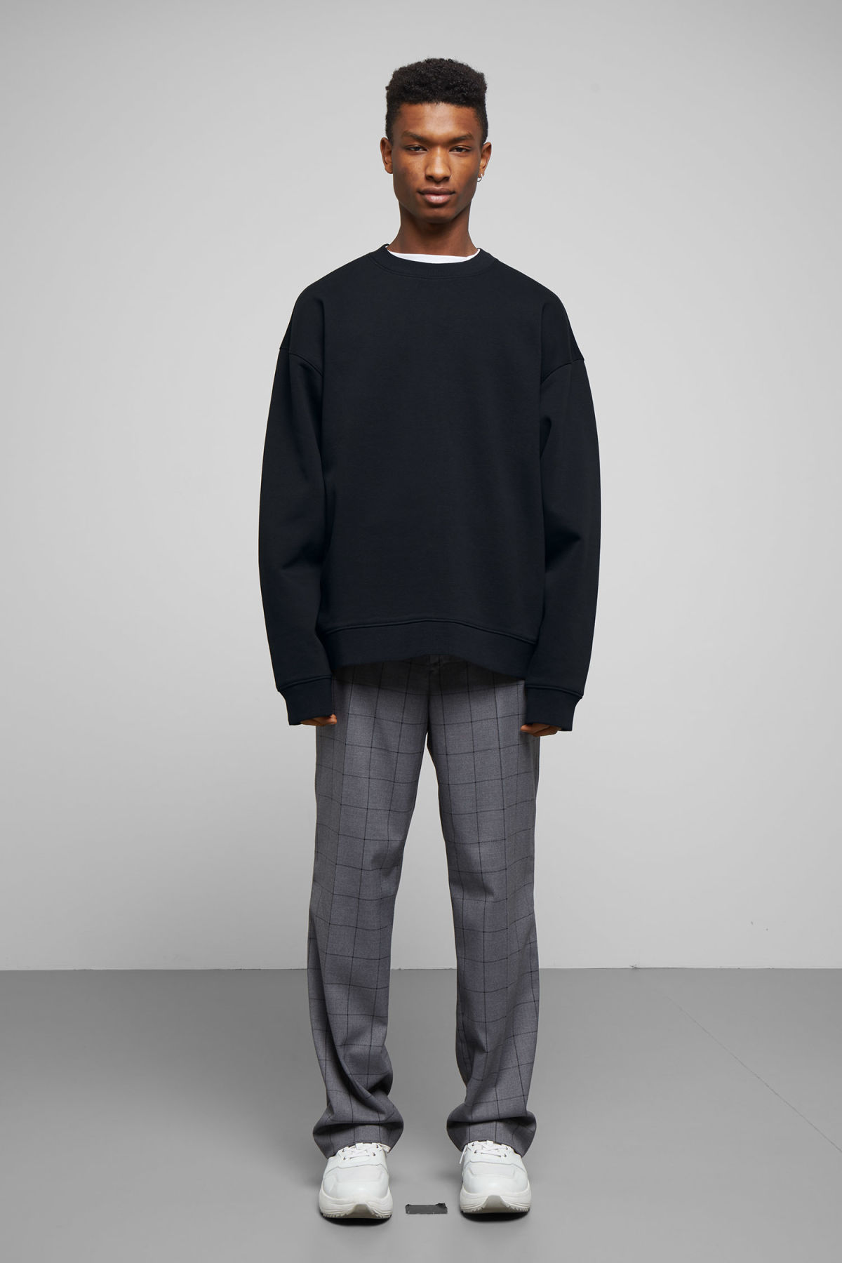 Model side image of Weekday big steve sweatshirt in black