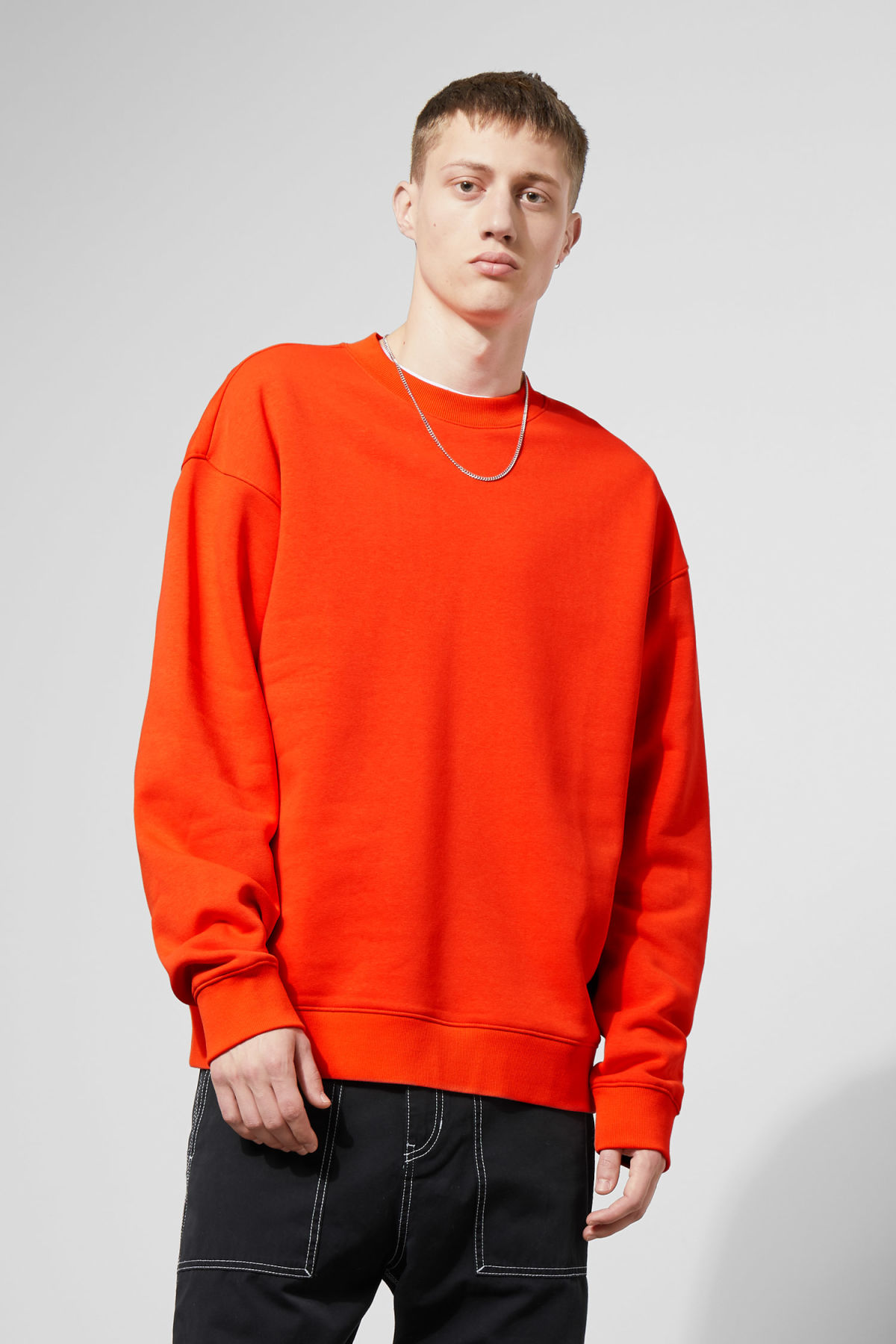 Model front image of Weekday big steve sweatshirt in orange