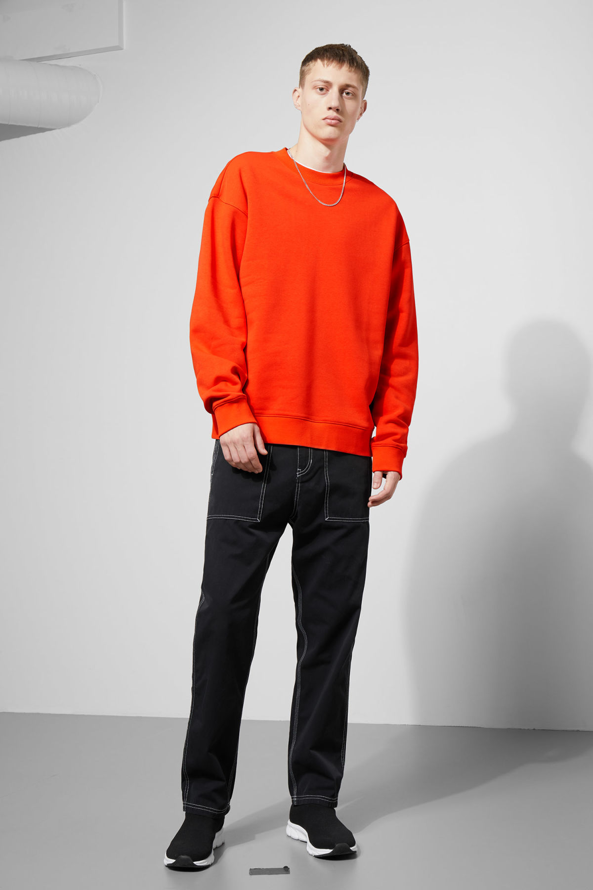 Model back image of Weekday big steve sweatshirt in orange