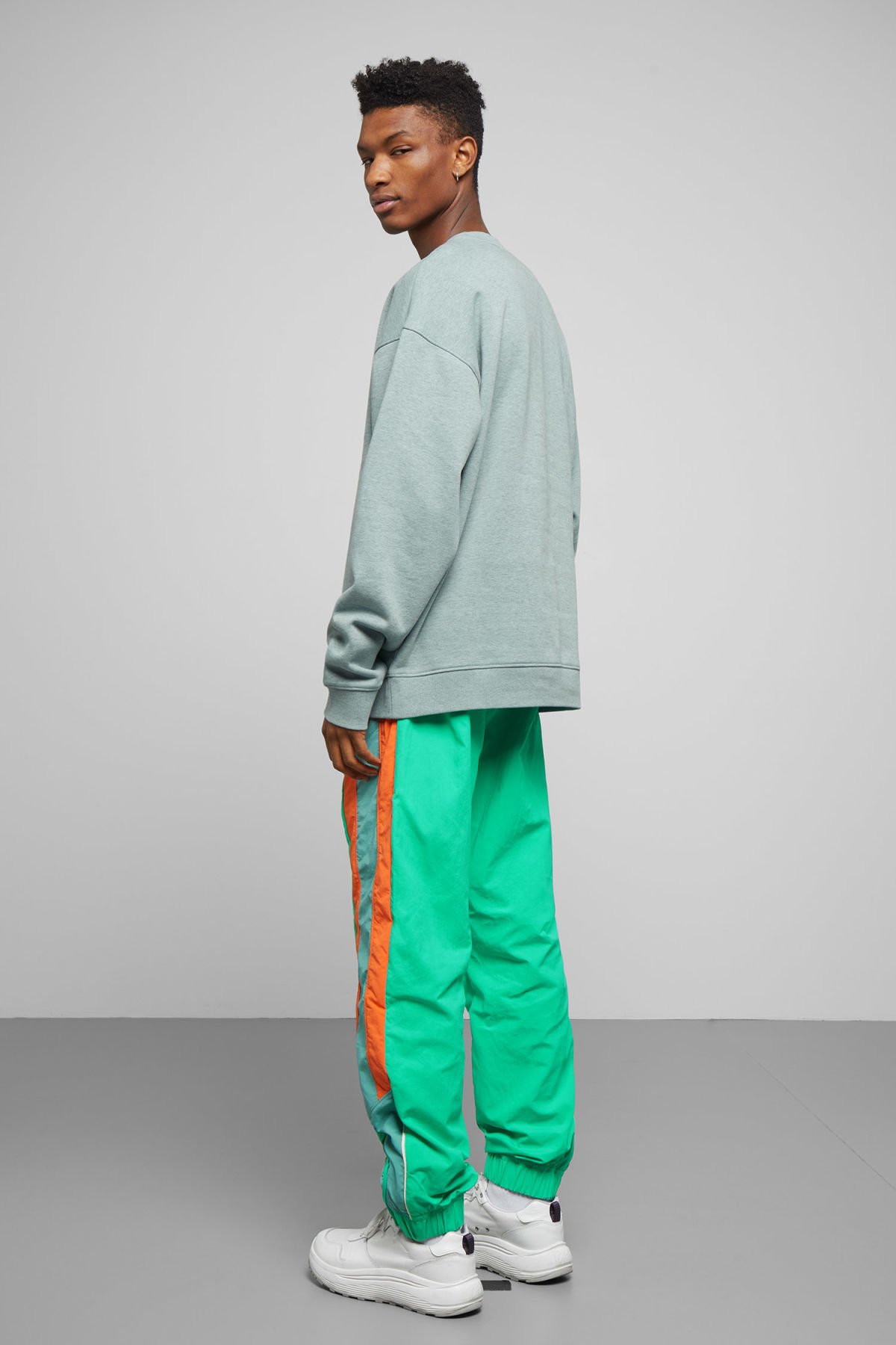 Model side image of Weekday big steve sweatshirt in turquoise