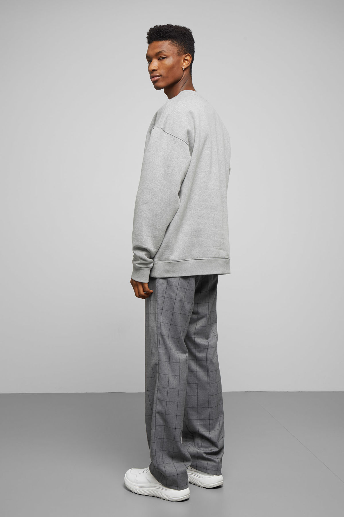 Model side image of Weekday big steve sweatshirt in grey