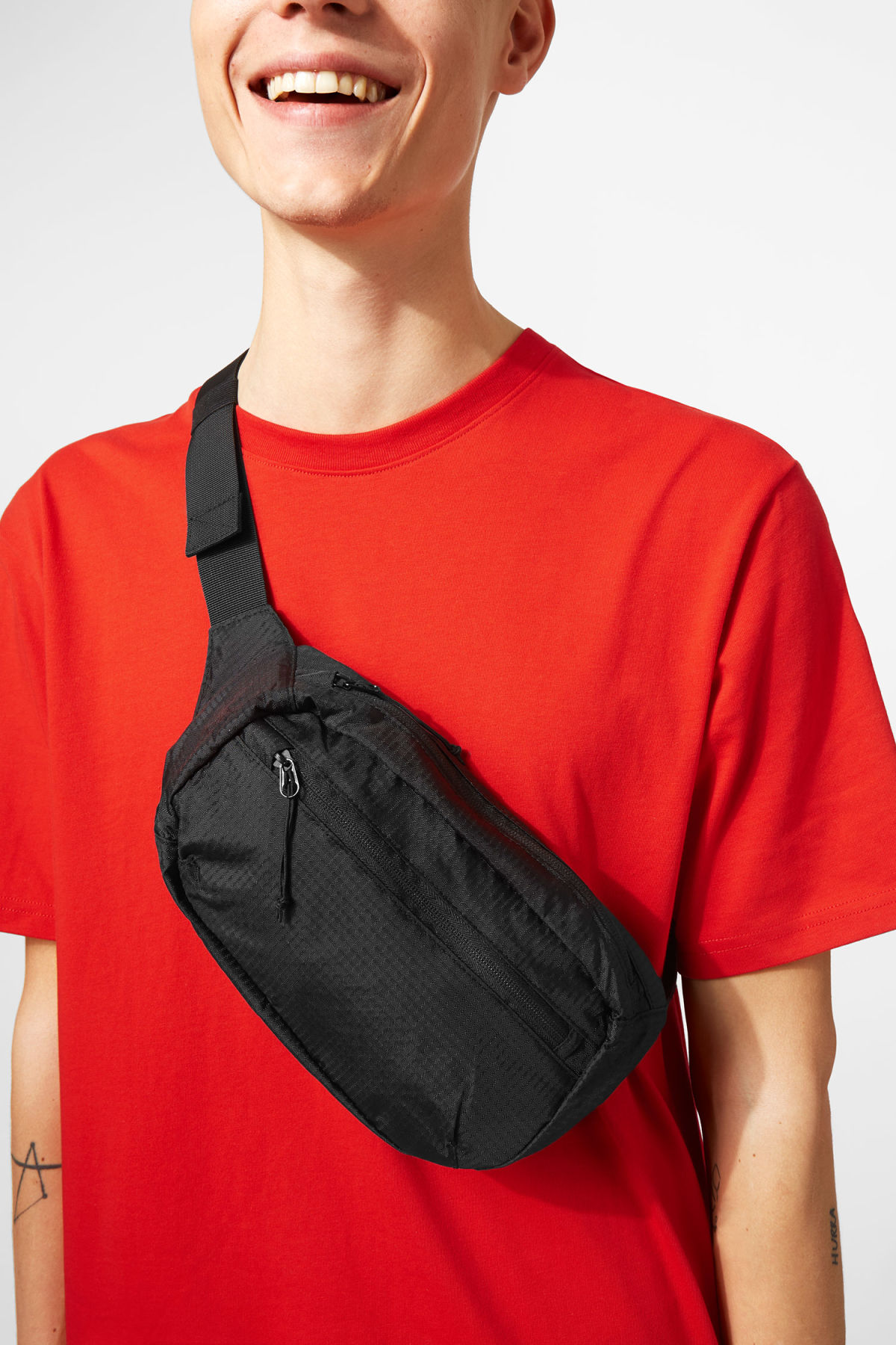 Model side image of Weekday trip waist bag in black