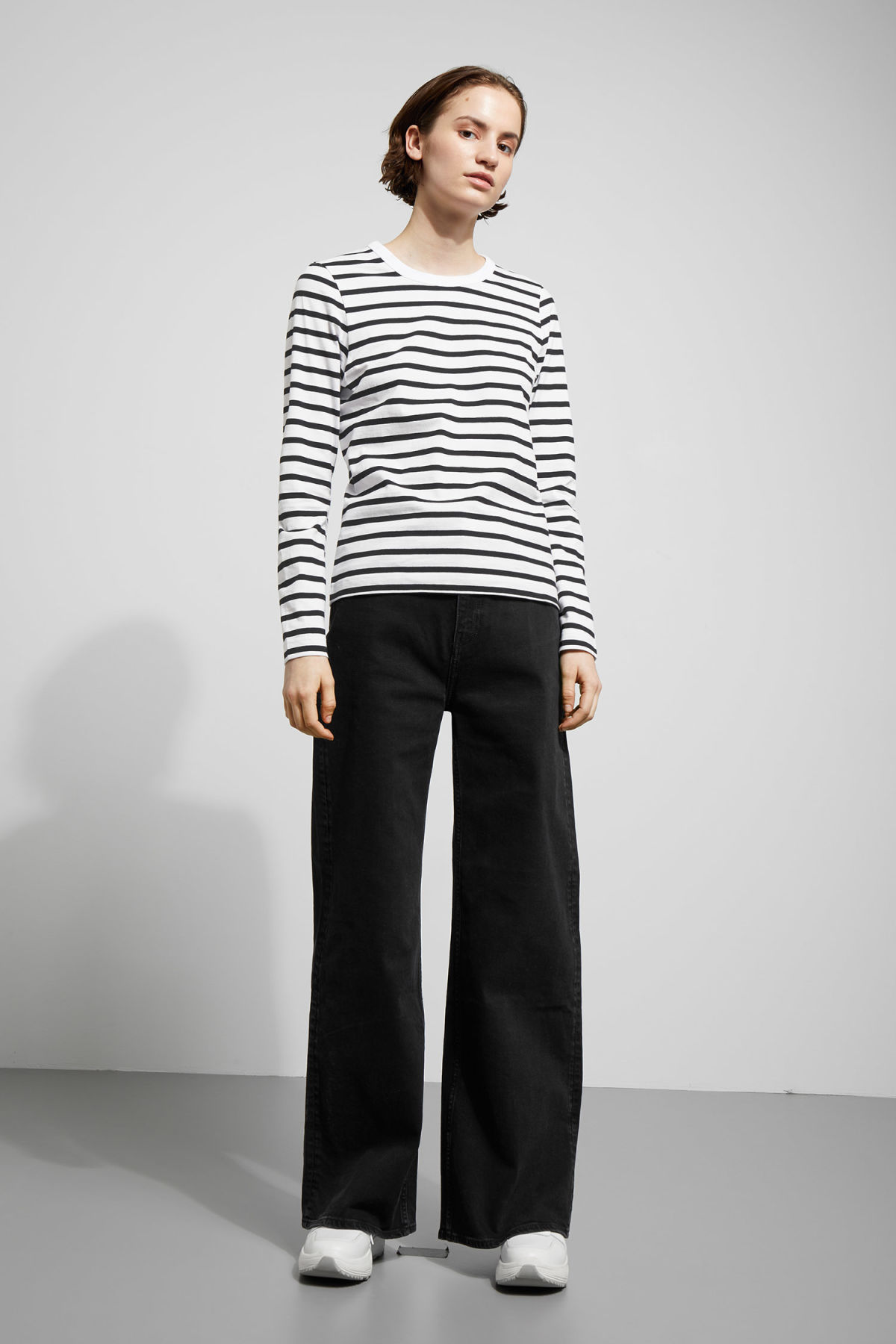 Model side image of Weekday kate striped long sleeve in black