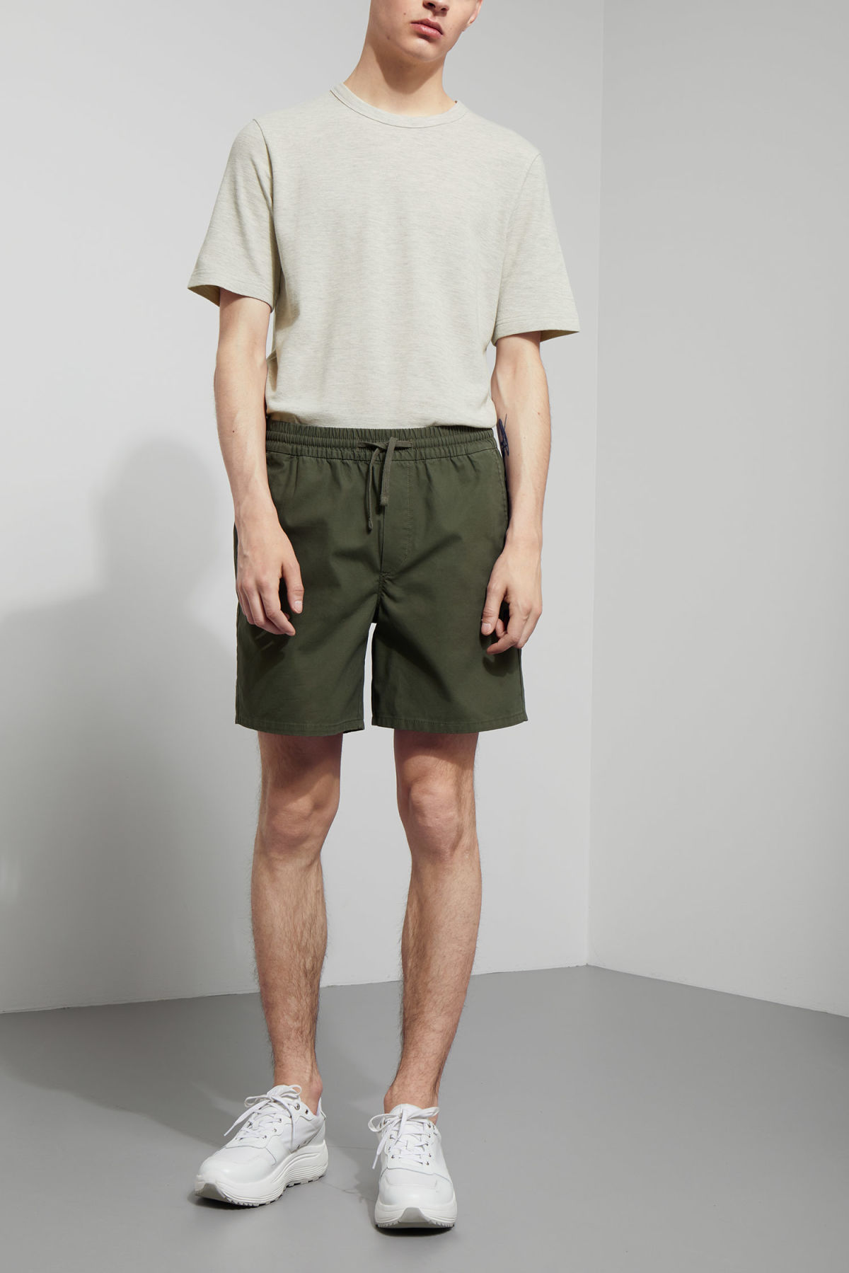 Model front image of Weekday olsen shorts in green