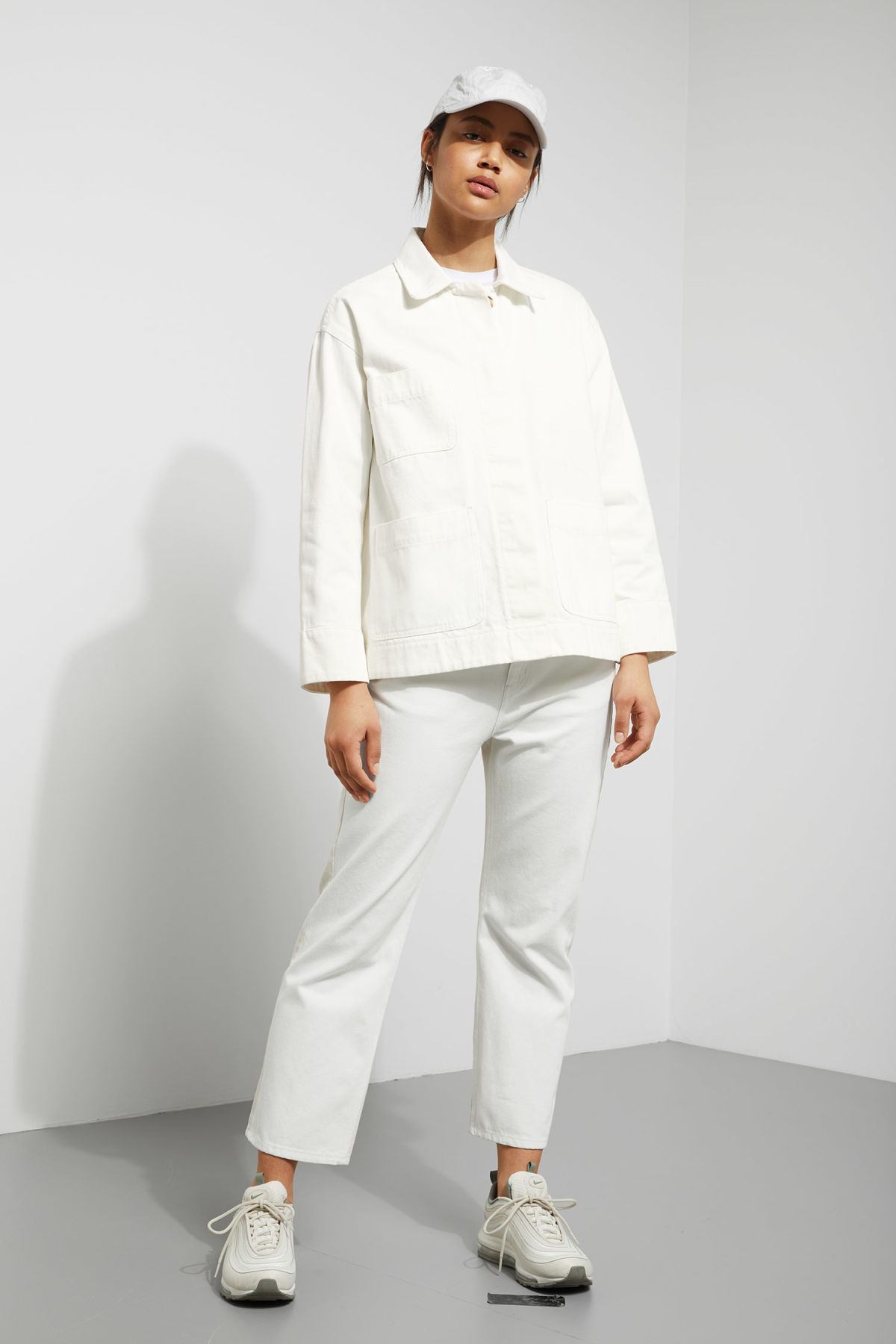 Model side image of Weekday ina jacket in white