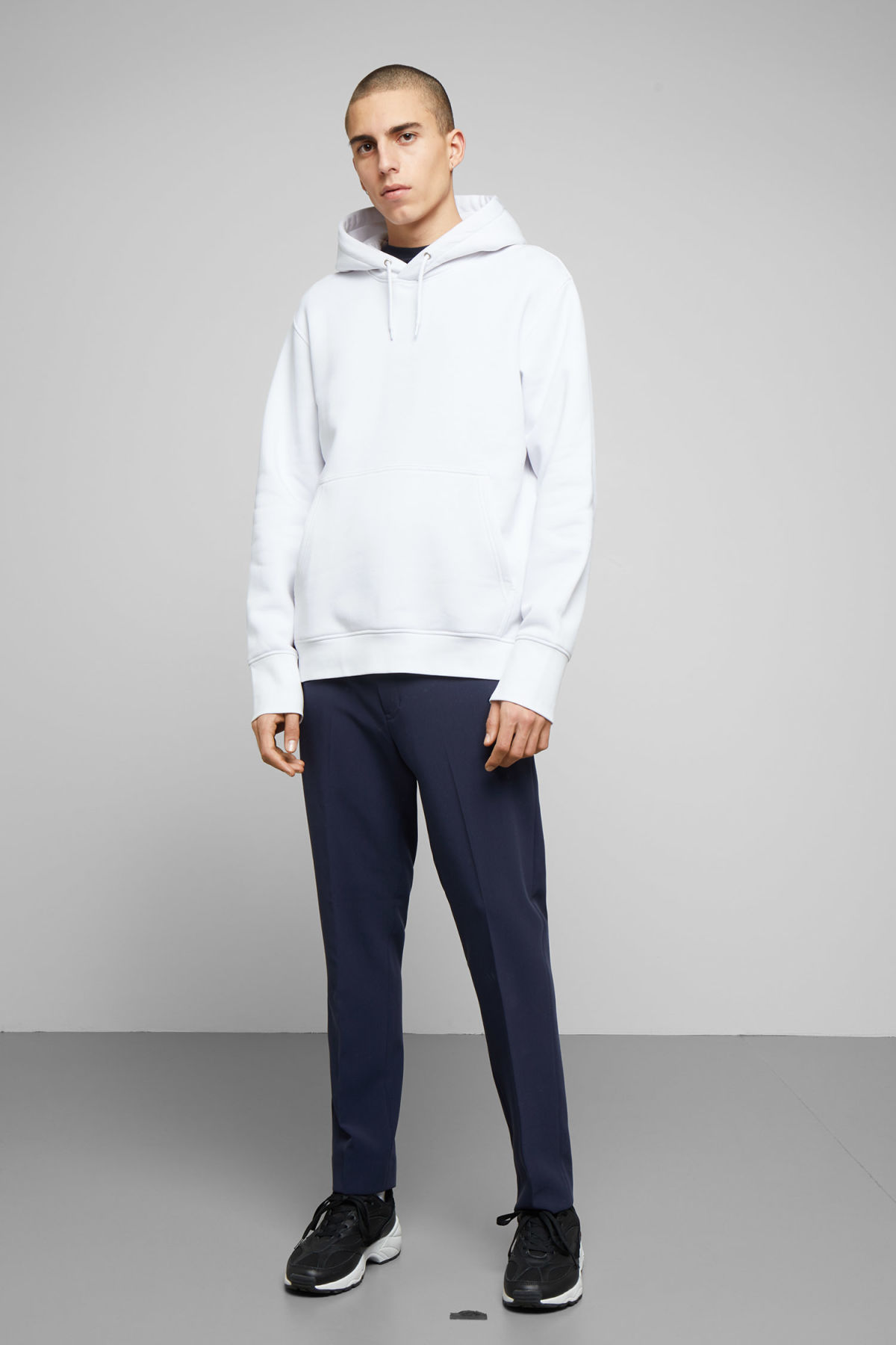 Model side image of Weekday hawk hoodie in white