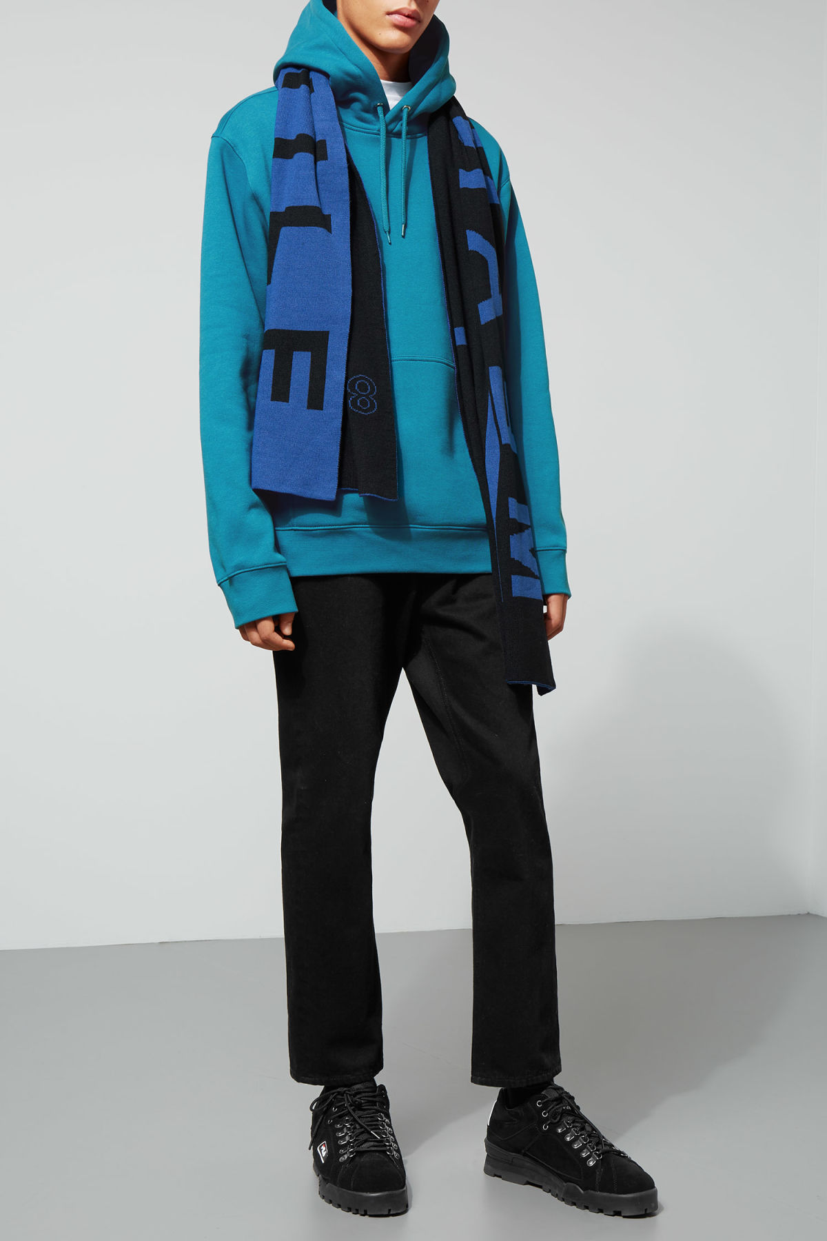 Model side image of Weekday hawk hoodie in turquoise