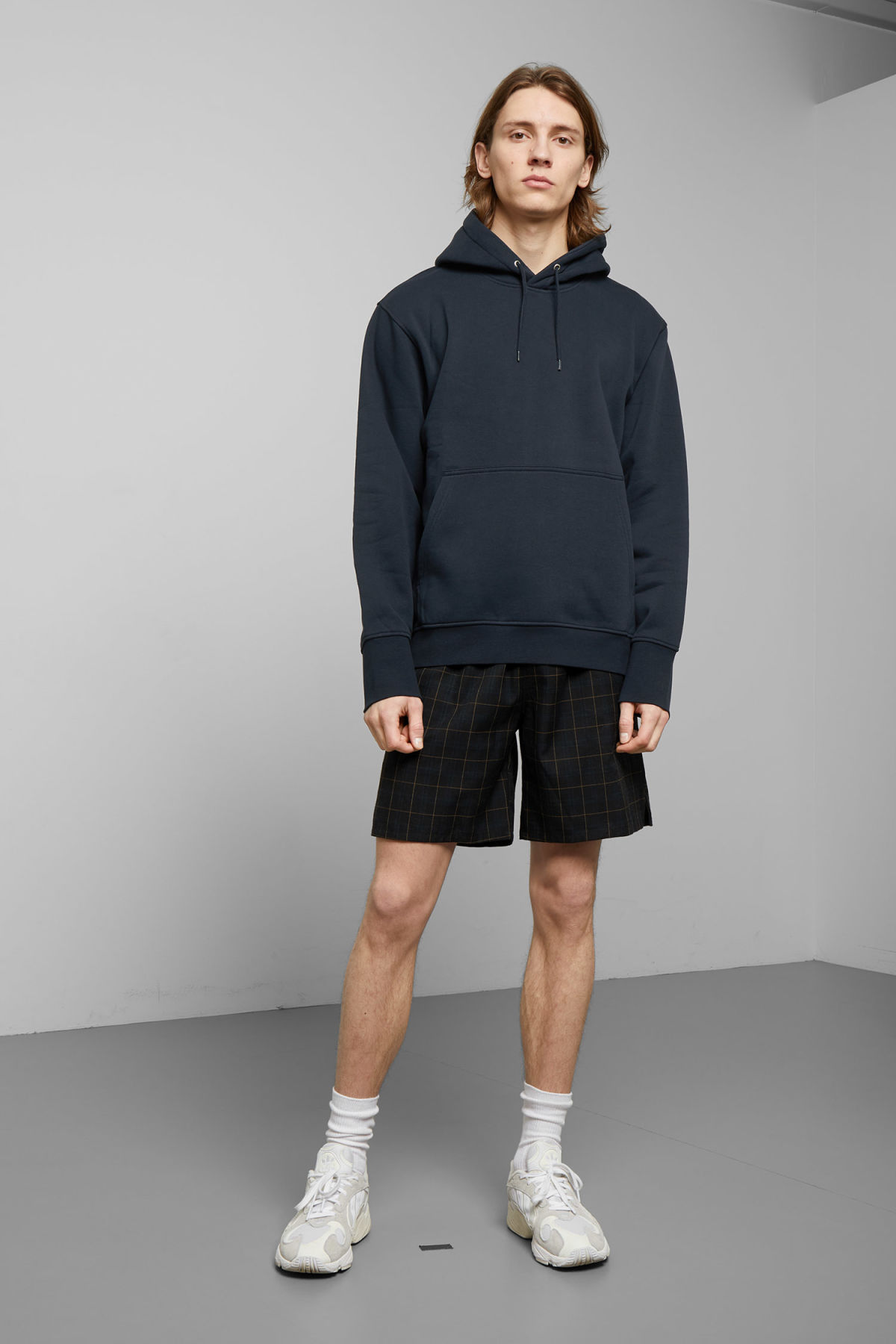 Model side image of Weekday hawk hoodie in blue