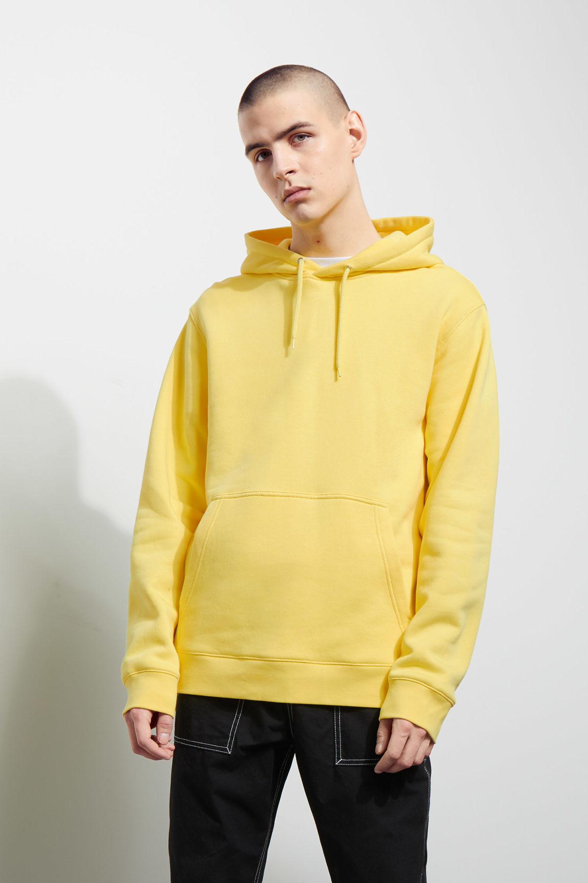 Model front image of Weekday hawk hoodie in yellow