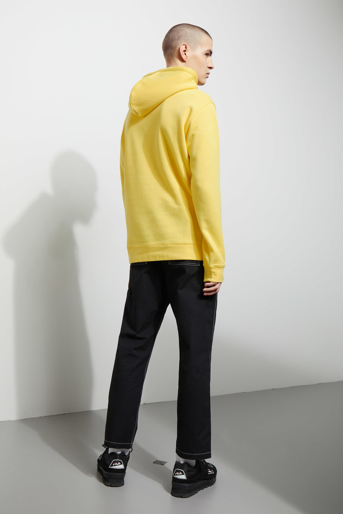 Model back image of Weekday hawk hoodie in yellow