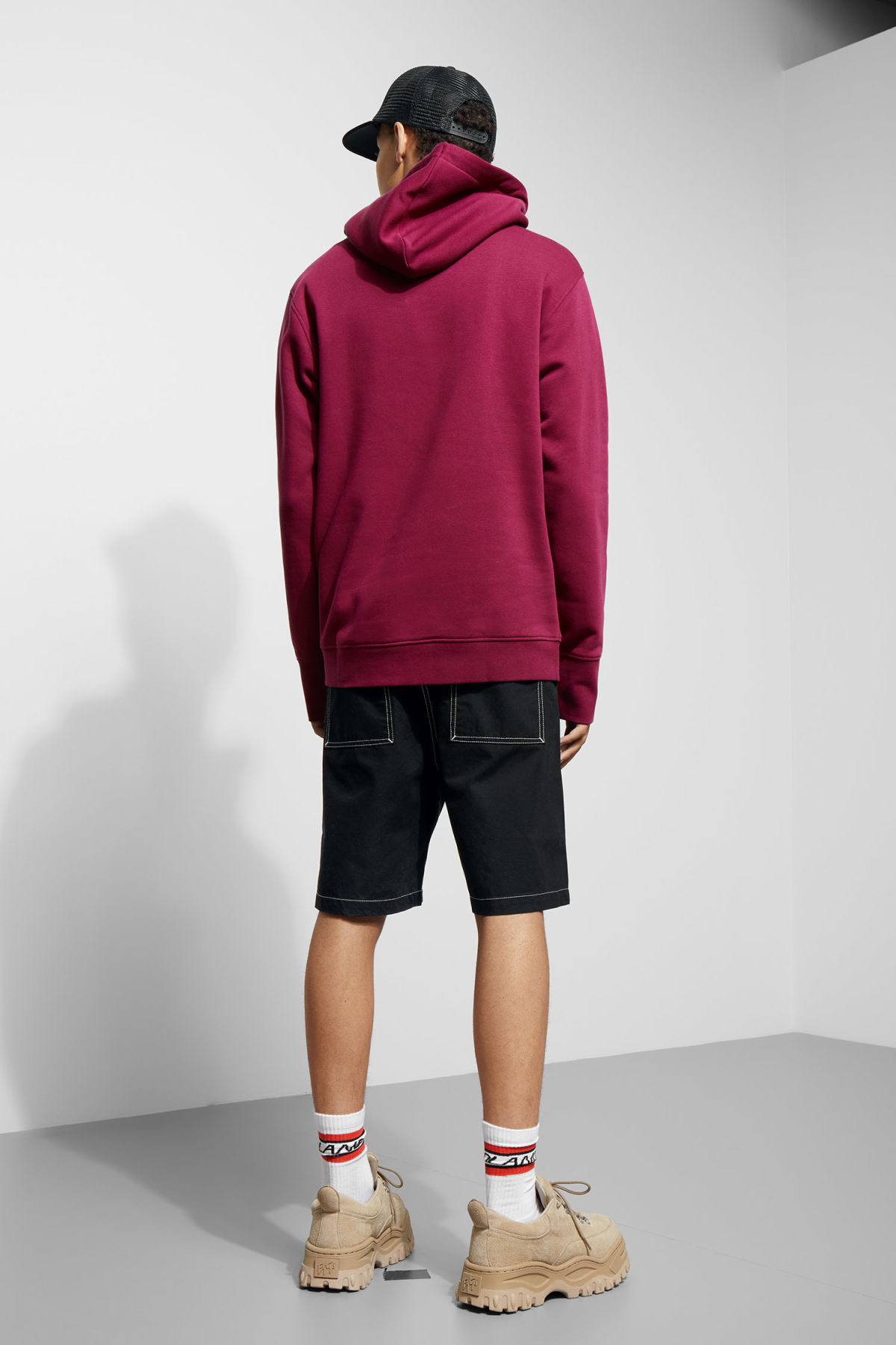 Model side image of Weekday hawk hoodie in pink