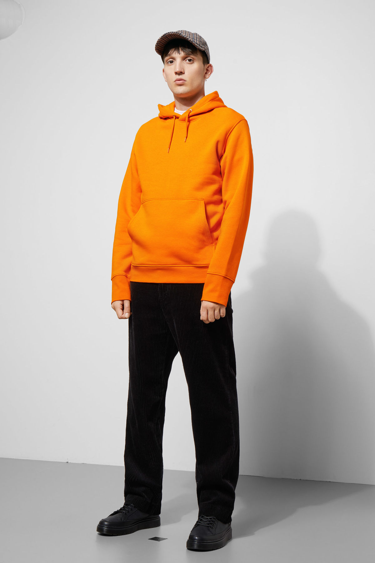 Model side image of Weekday hawk hoodie in orange