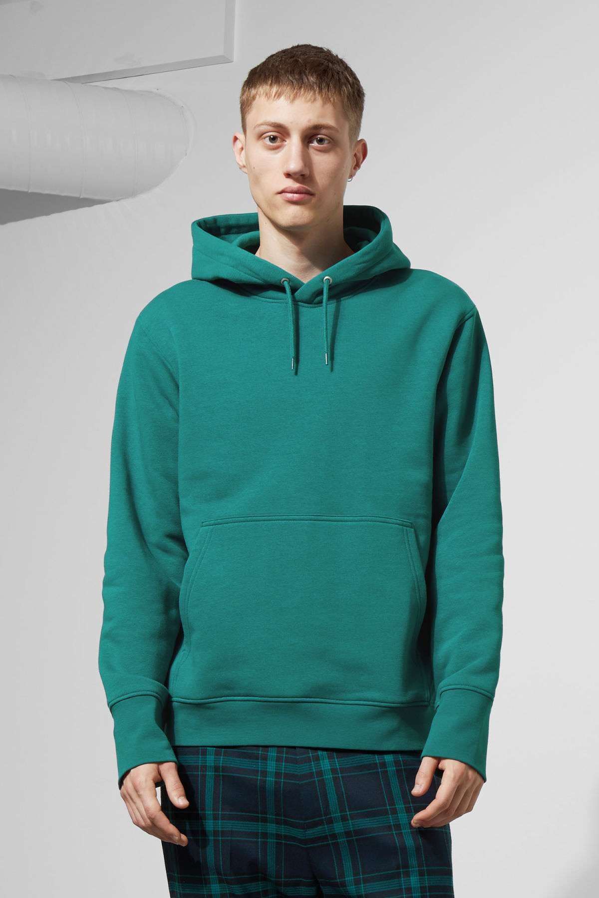 Model front image of Weekday hawk hoodie in turquoise