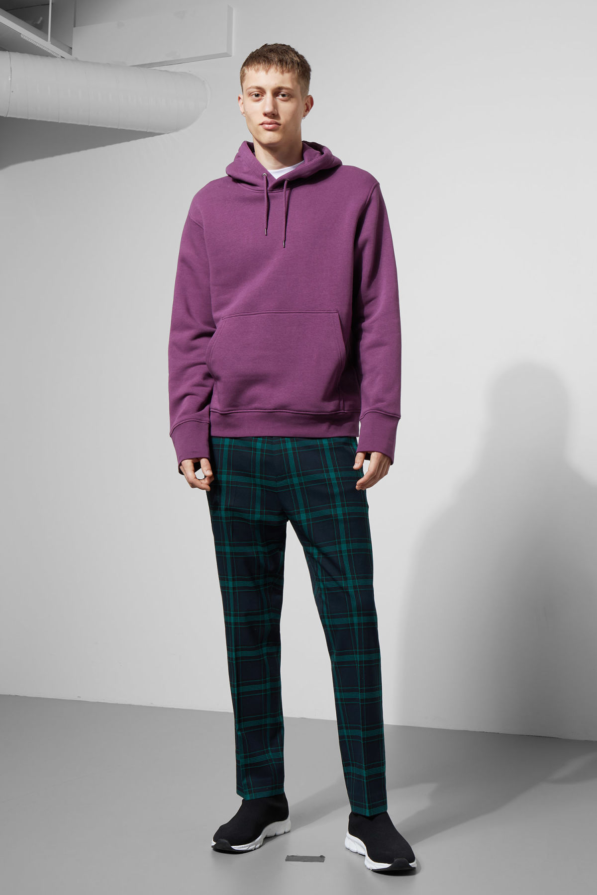 Model side image of Weekday hawk hoodie in purple