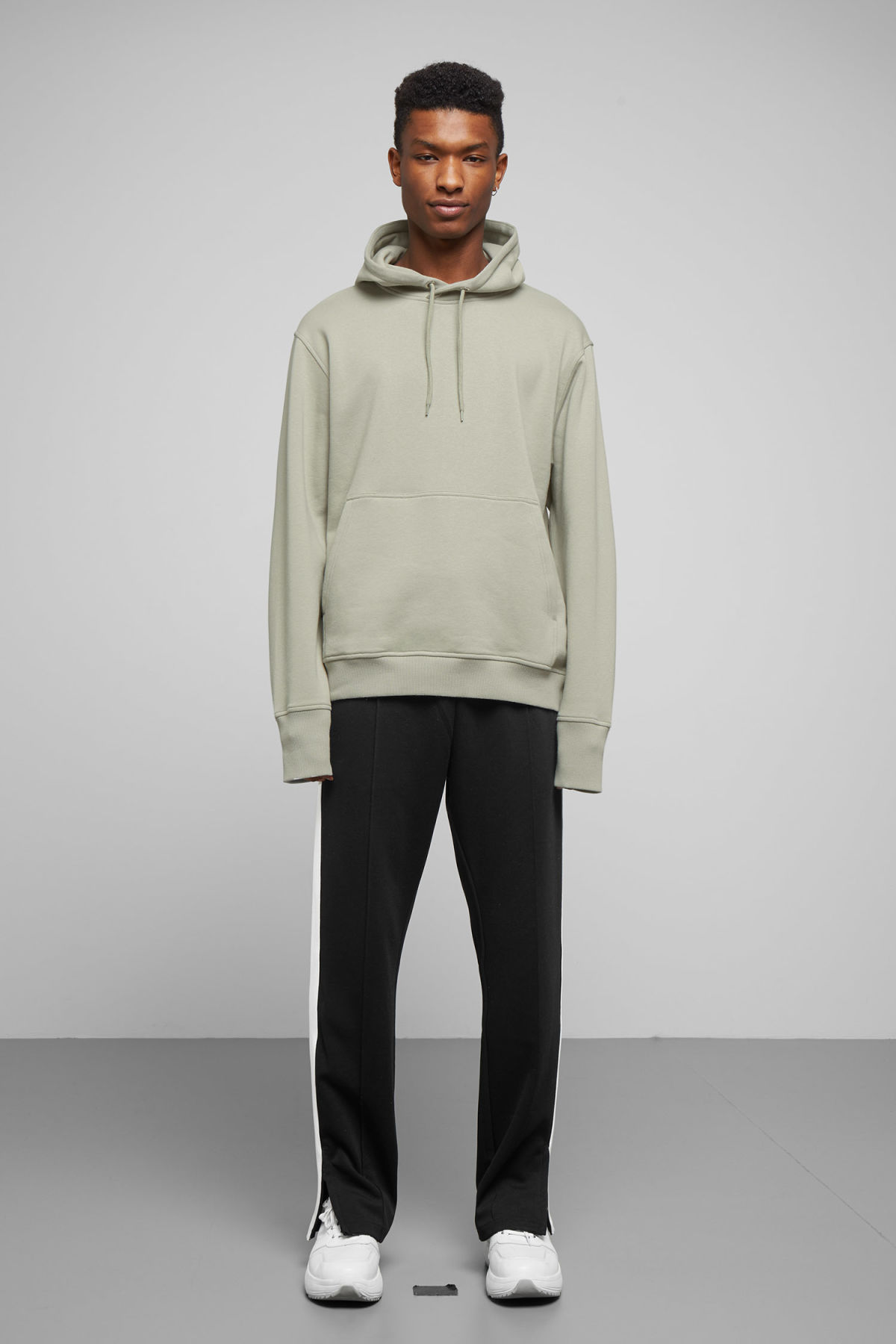 Model side image of Weekday hawk hoodie in green