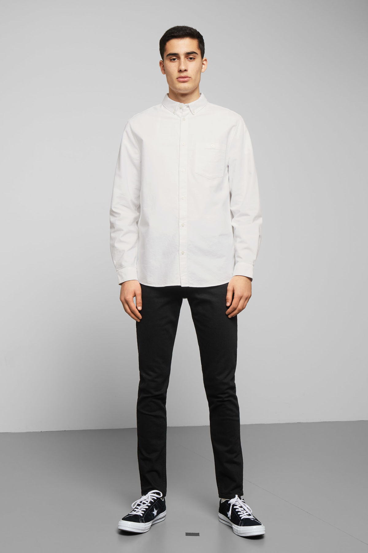 Model side image of Weekday bad times shirt in white