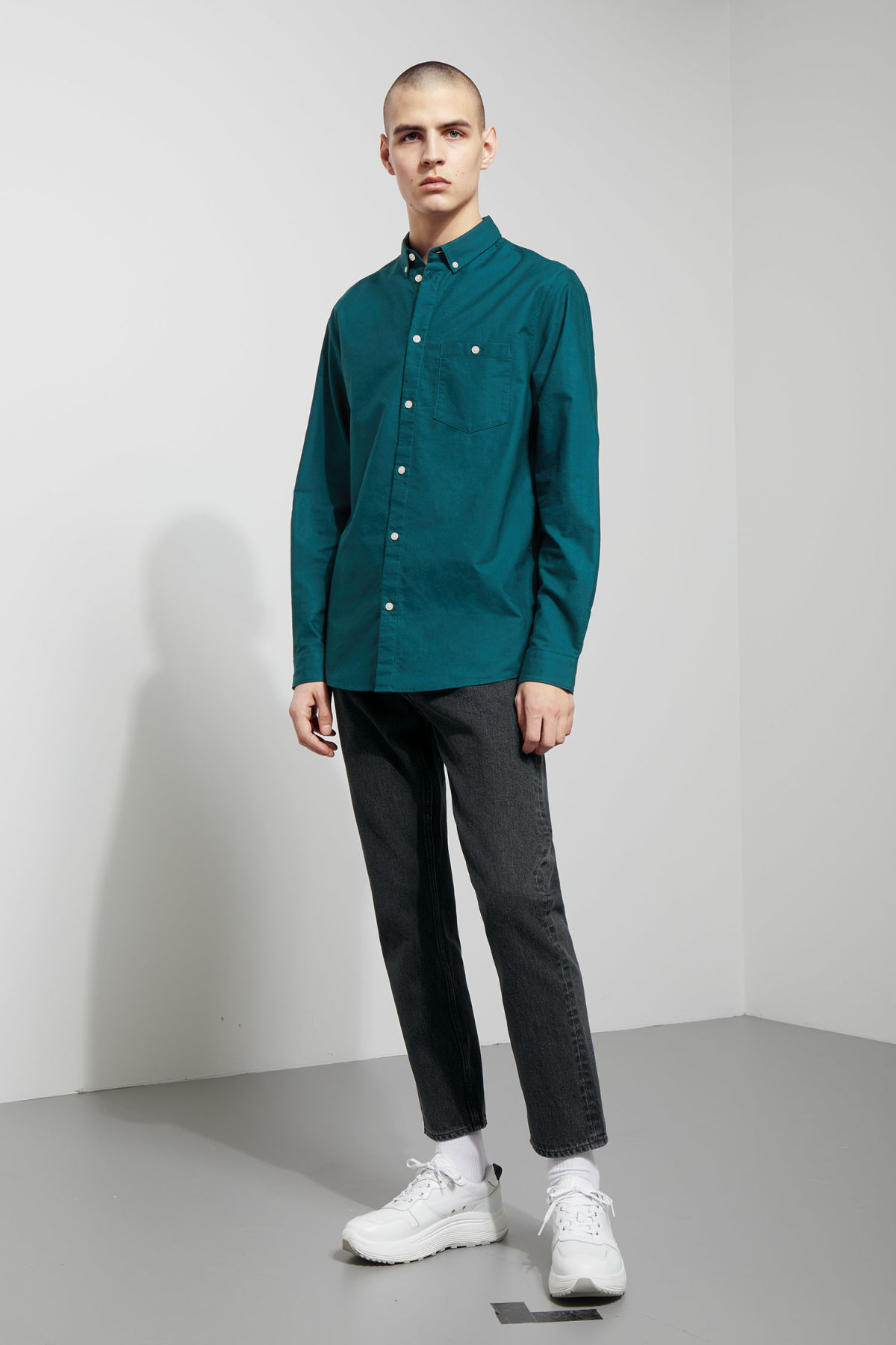 Model side image of Weekday bad times shirt in turquoise
