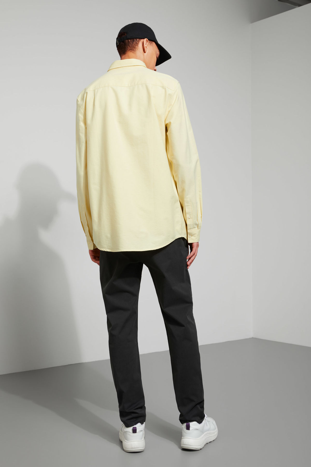Model back image of Weekday bad times shirt in yellow
