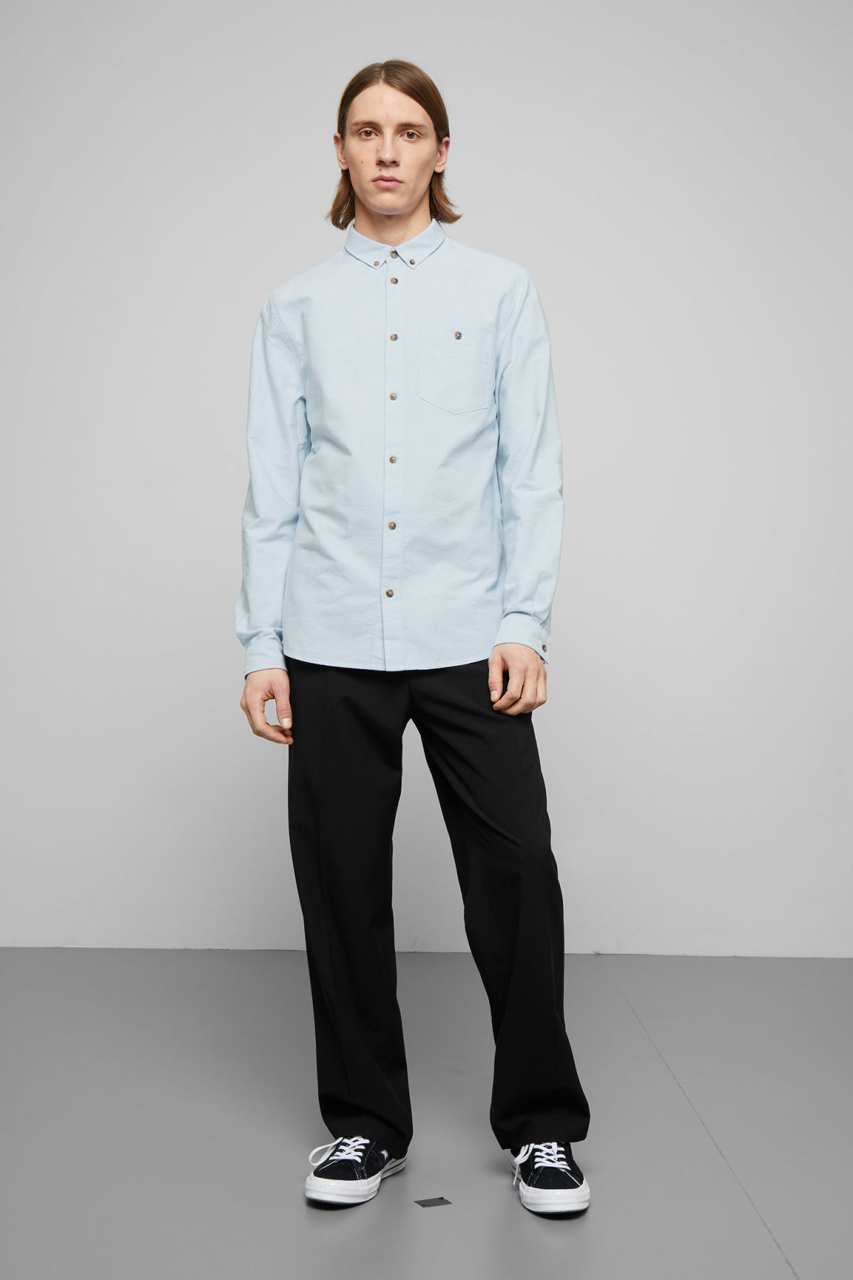 Model side image of Weekday bad times shirt in blue