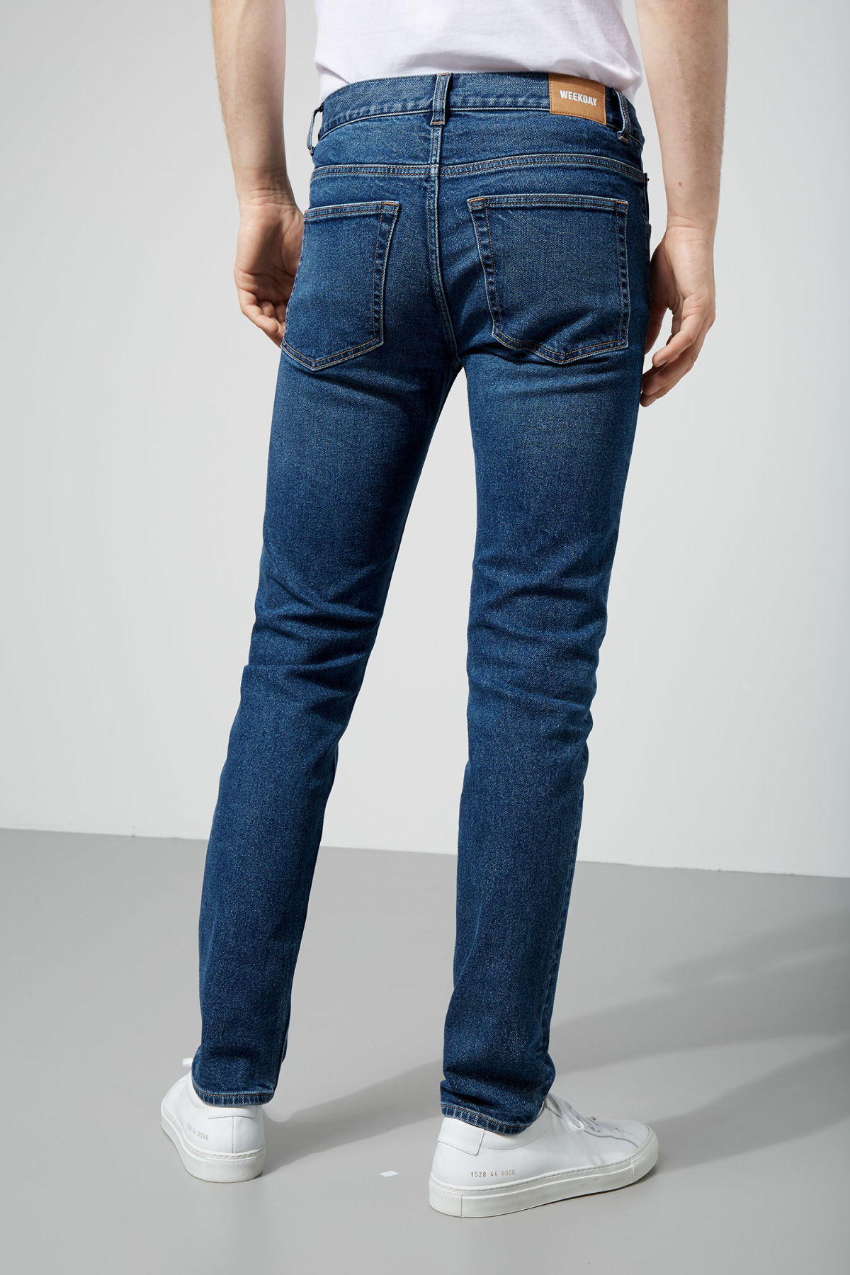 Model side image of Weekday friday peralta blue jeans in blue