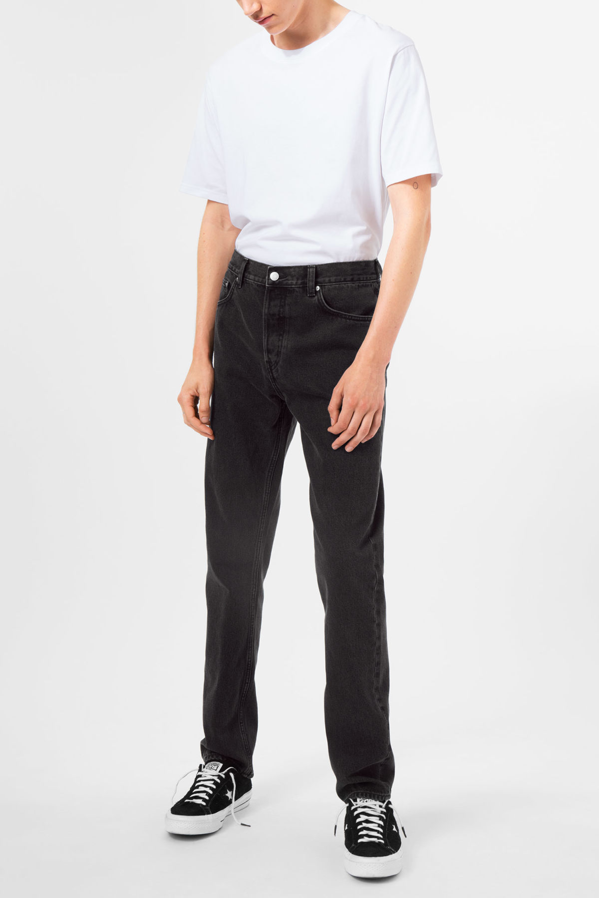 Model side image of Weekday line washed black jeans in black