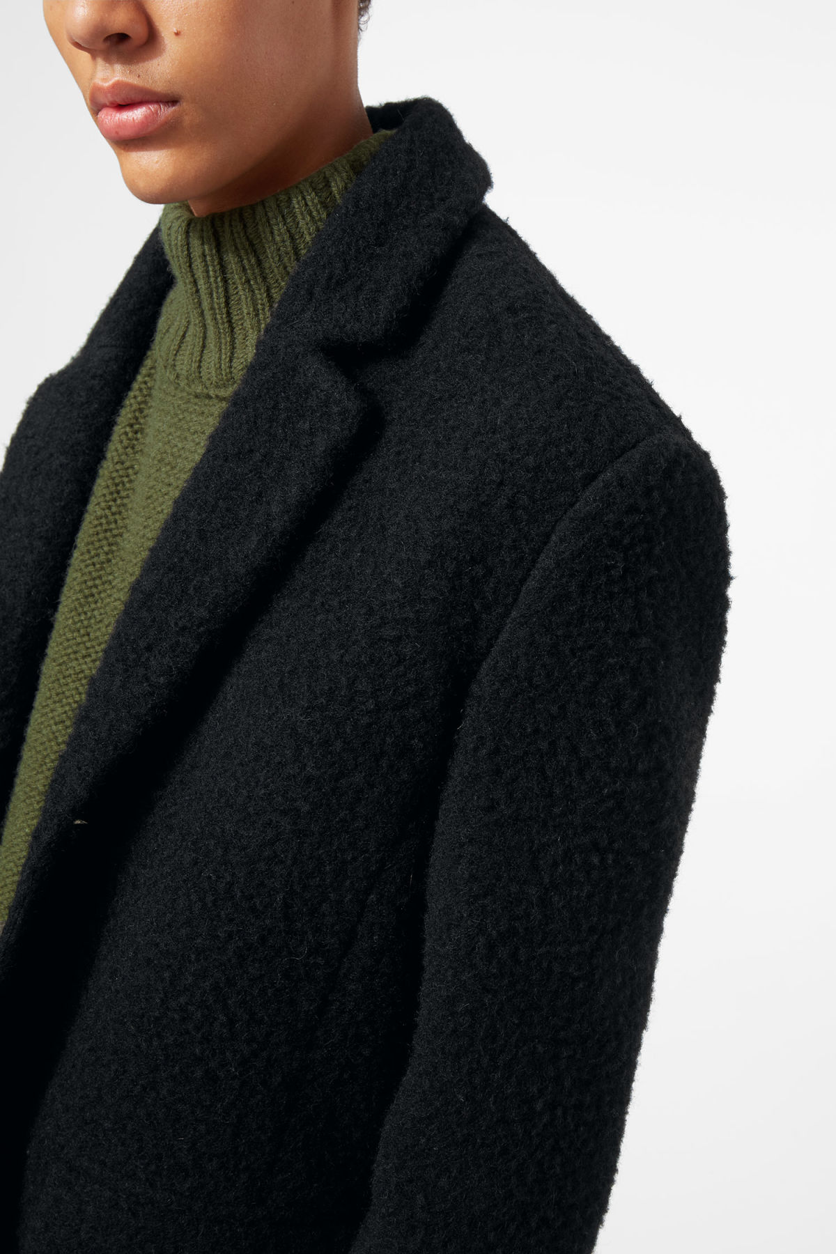 Model side image of Weekday zeke knitted coat in black