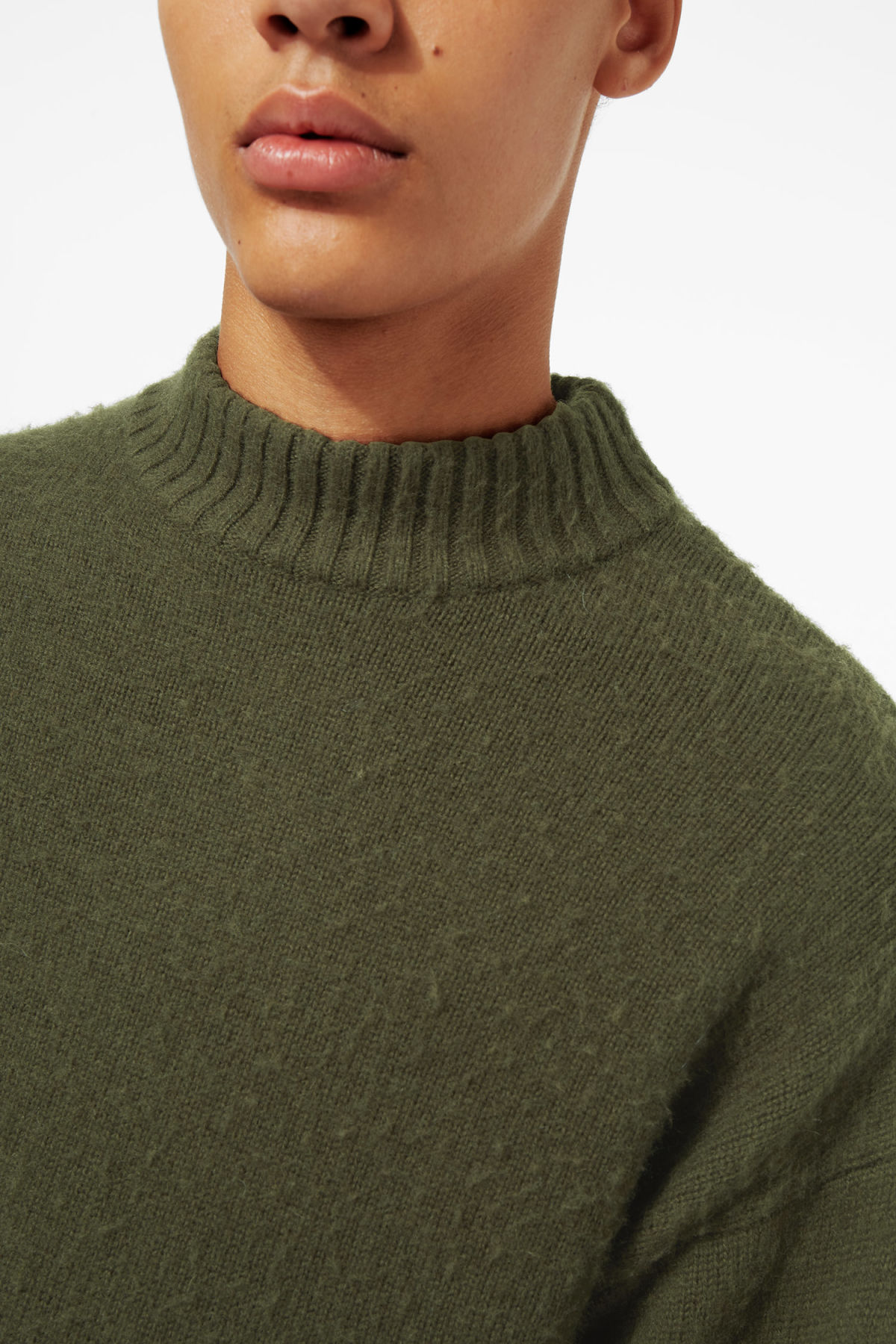 Model side image of Weekday rock sweater in green