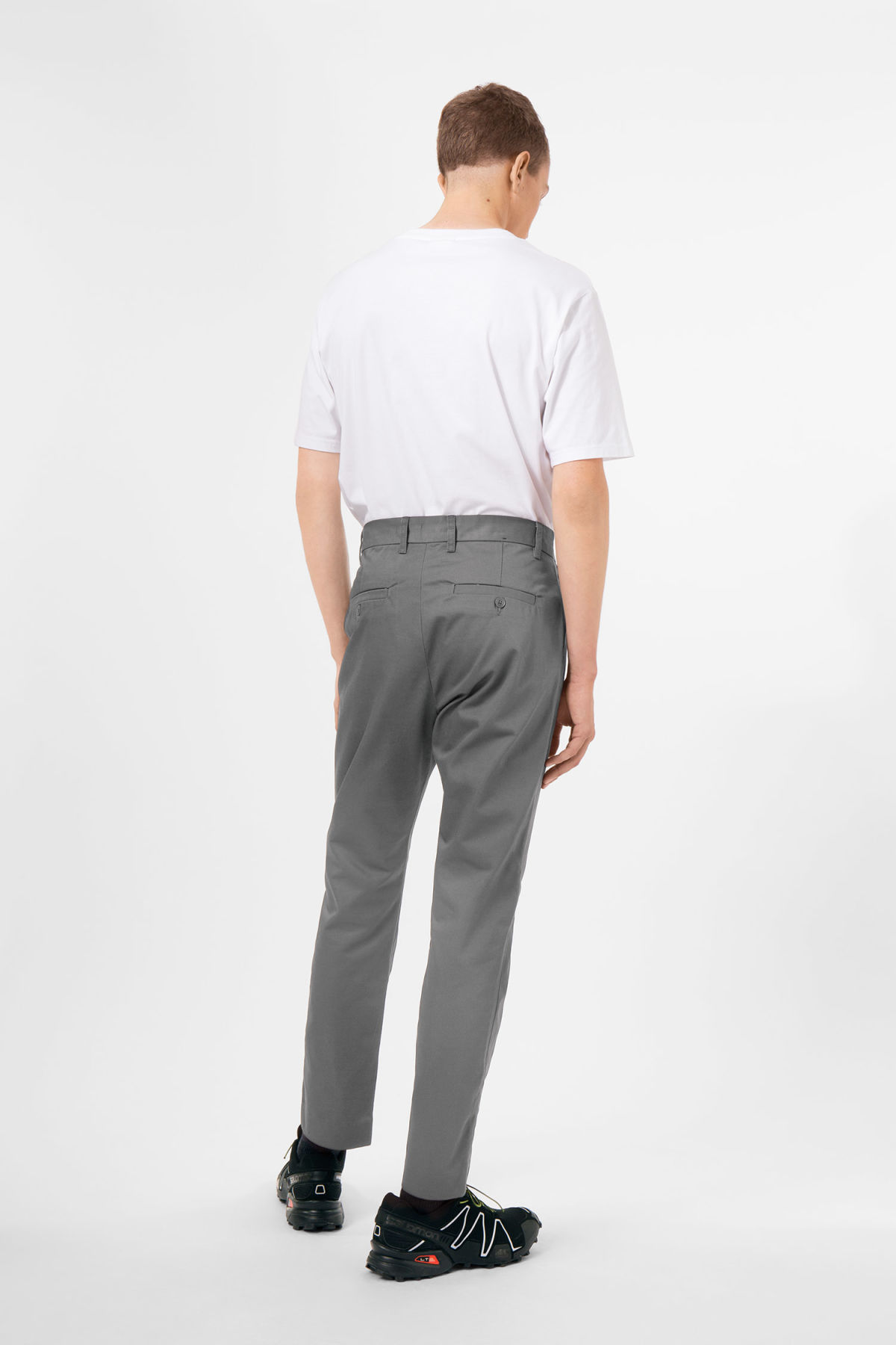 Model side image of Weekday forest chinos in grey