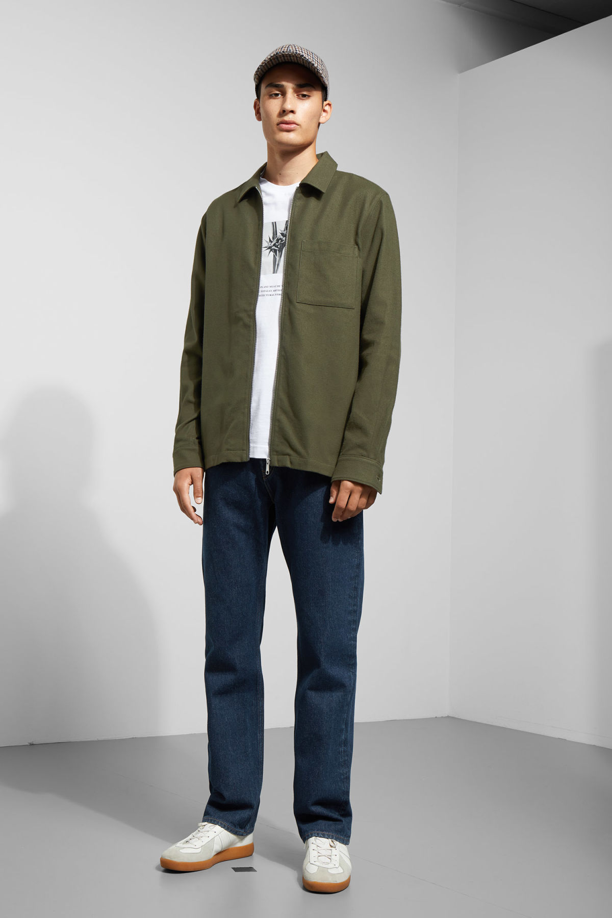 Model side image of Weekday temp rugged shirt in green