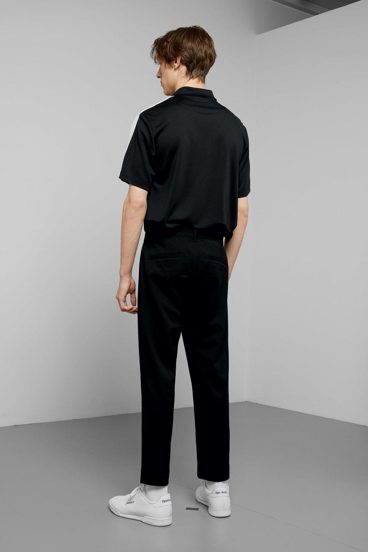 Model side image of Weekday mard crepe trousers in black