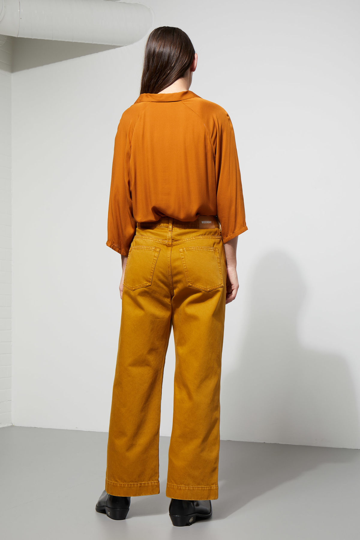Model side image of Weekday franca blouse in yellow
