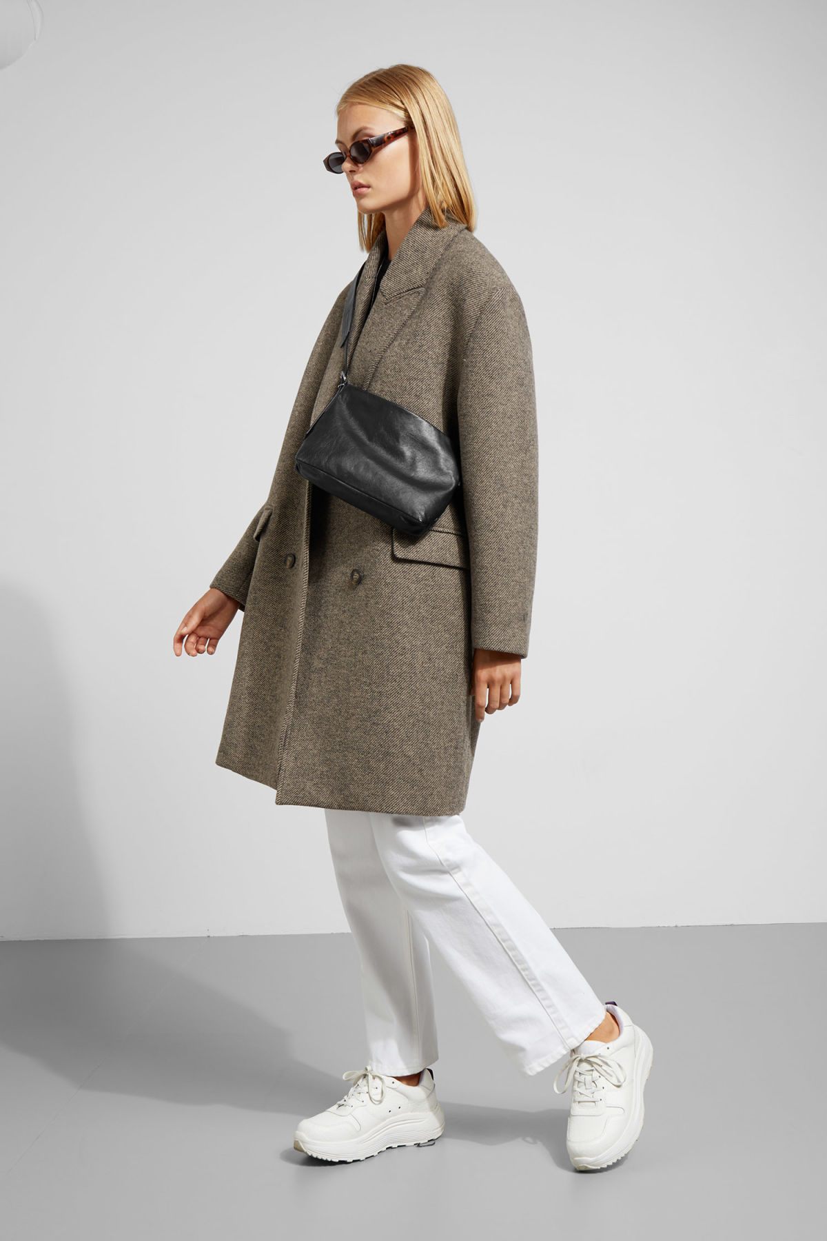 Model side image of Weekday michelle coat in brown