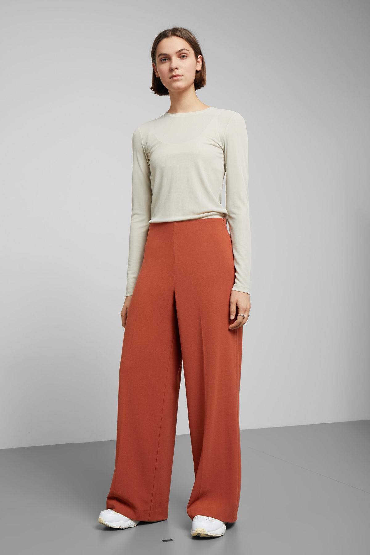 Model front image of Weekday julia trousers  in orange