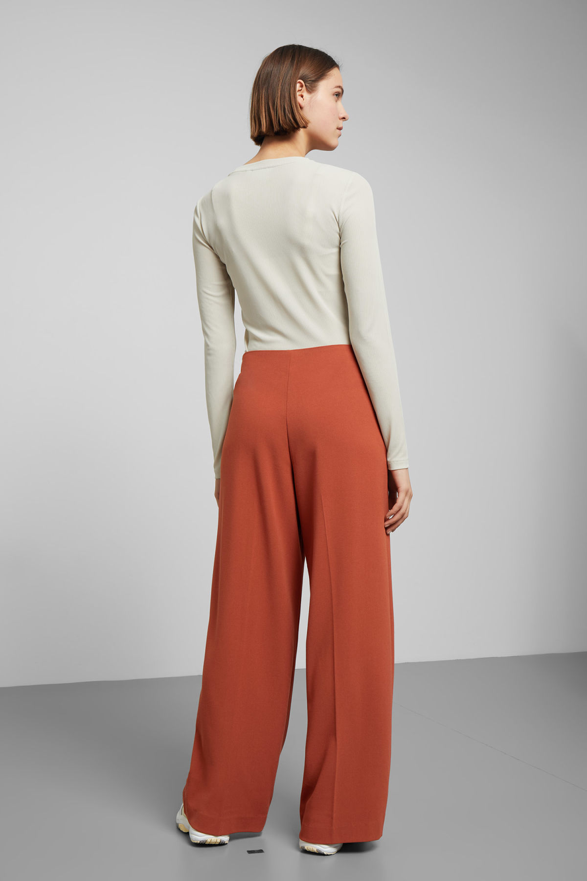 Model back image of Weekday julia trousers  in orange