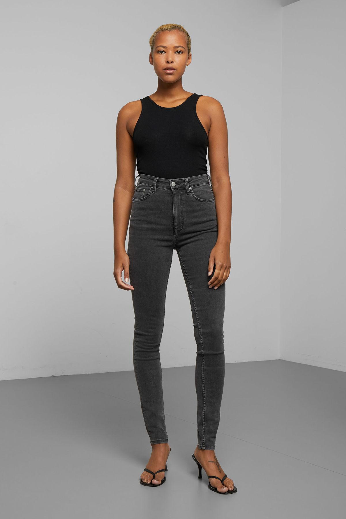 Model front image of Weekday body high perfect black jeans in black