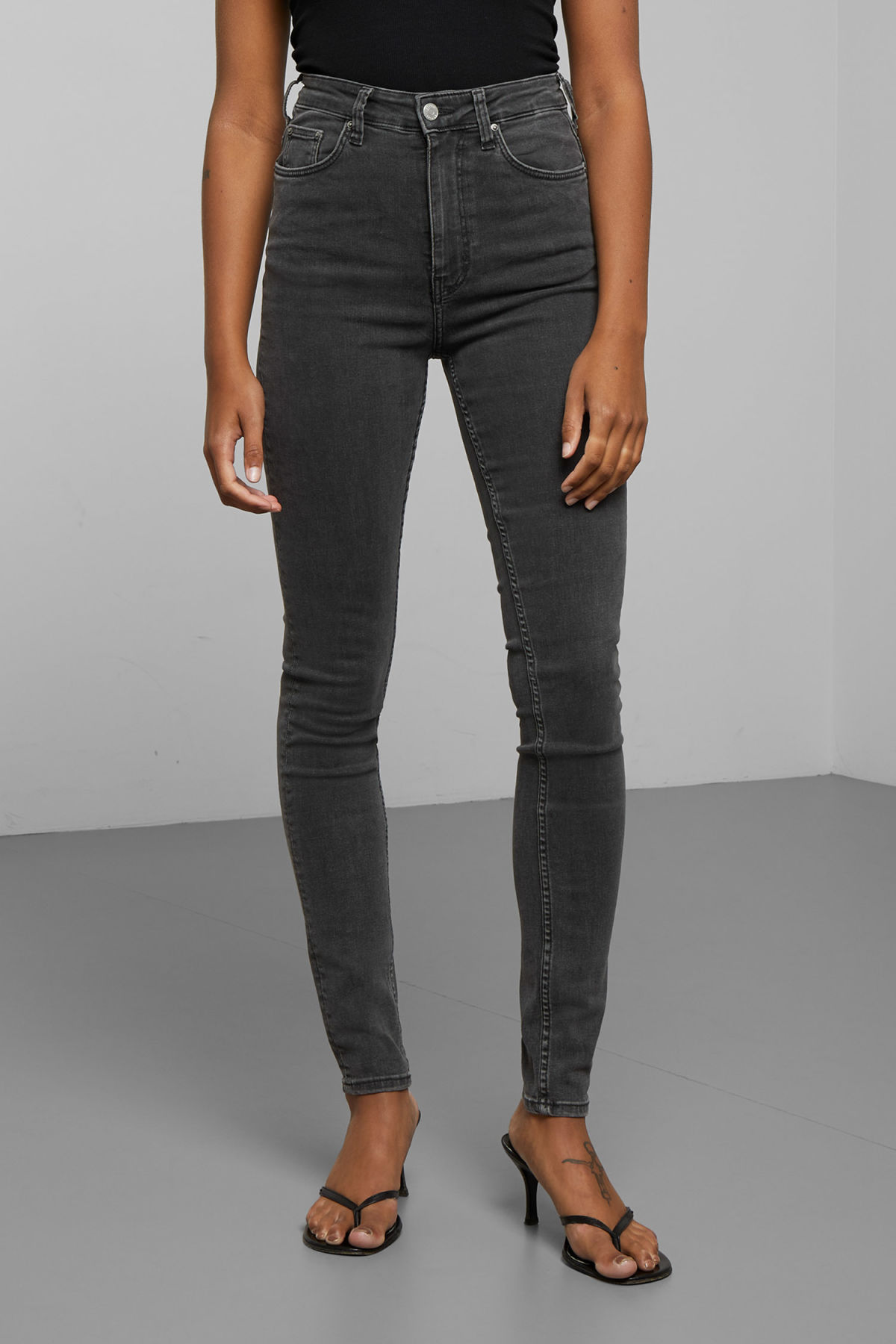Model back image of Weekday body high perfect black jeans in black