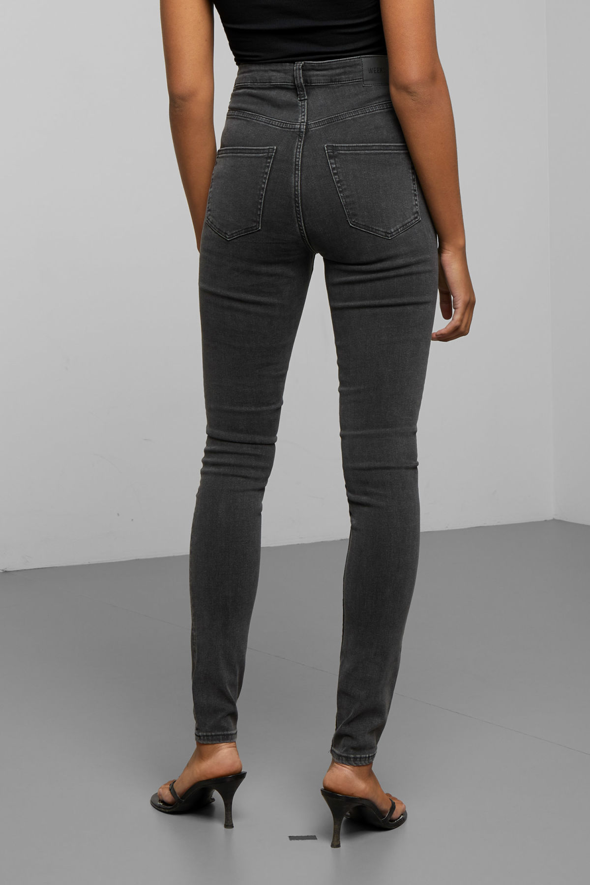 Model side image of Weekday body high perfect black jeans in black