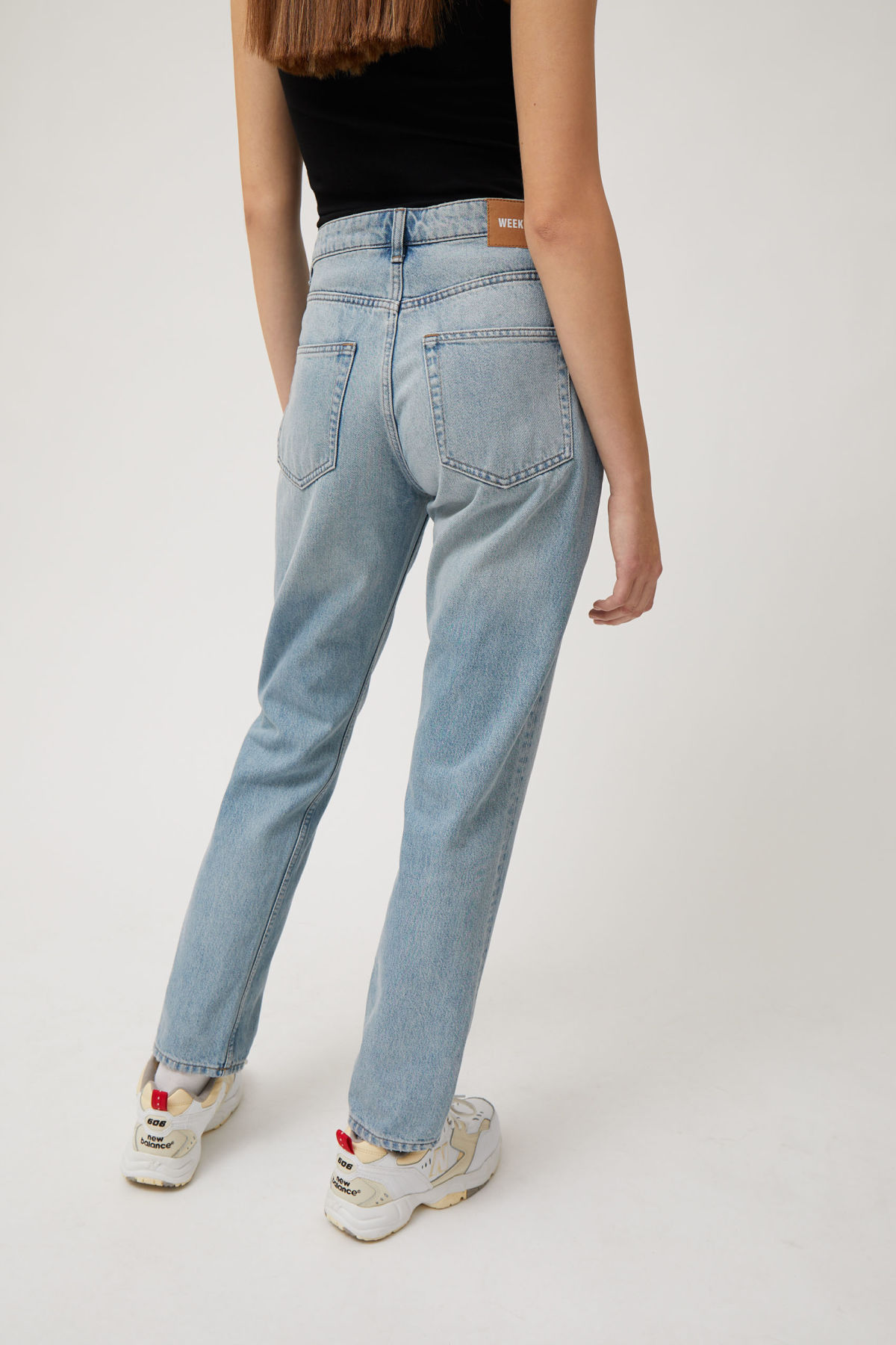 Model side image of Weekday seattle week blue jeans in blue