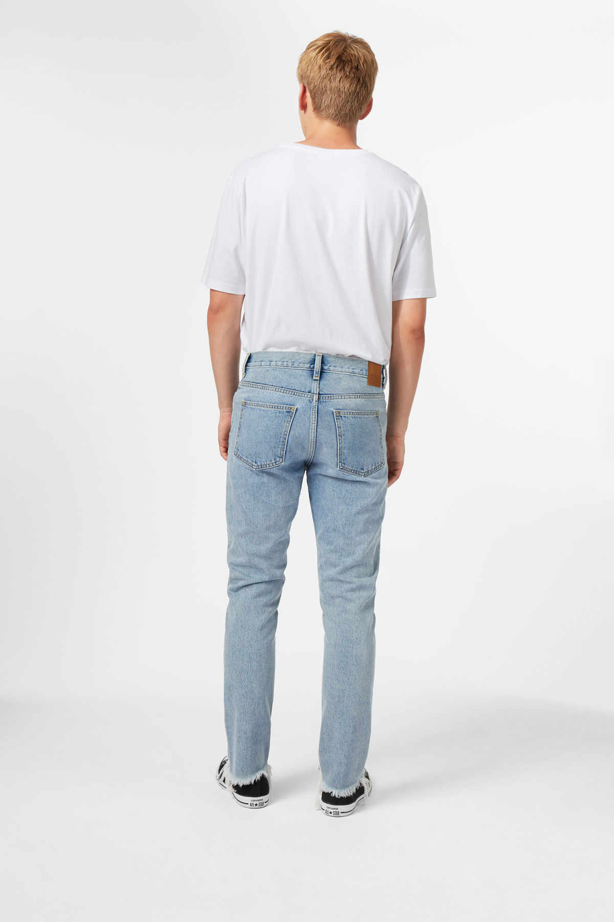 Model side image of Weekday sharp lagoon blue jeans in blue