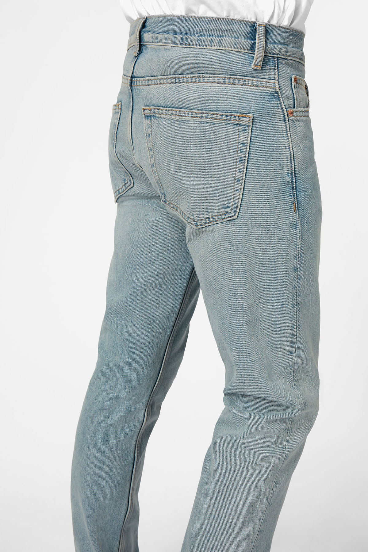 Model side image of Weekday sharp mid pure blue jeans in blue