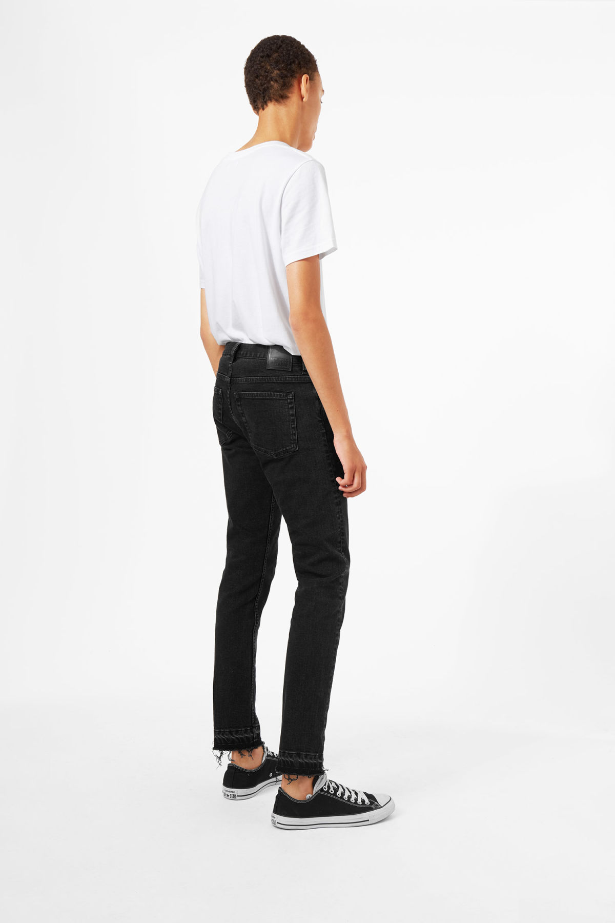 Model side image of Weekday friday decon short black jeans in black
