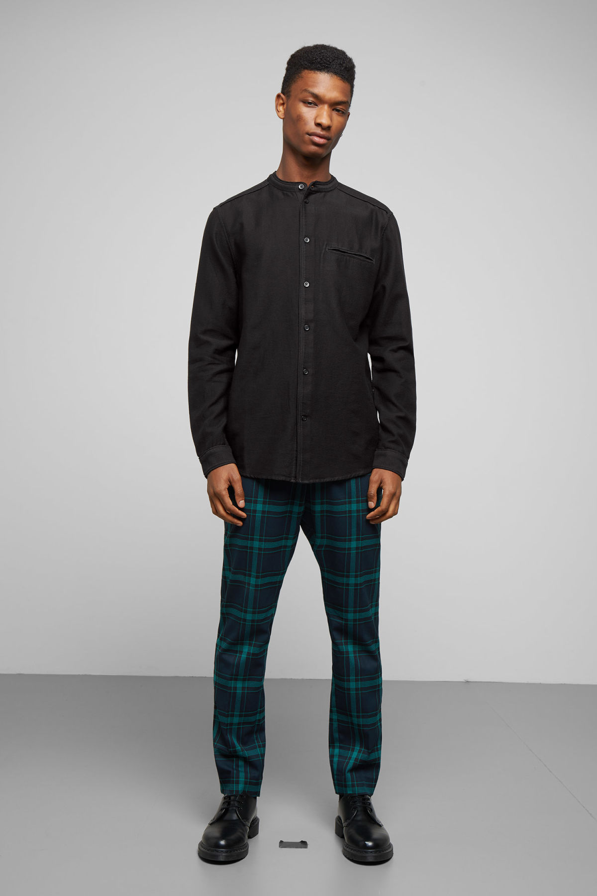Model side image of Weekday hunt shirt in black