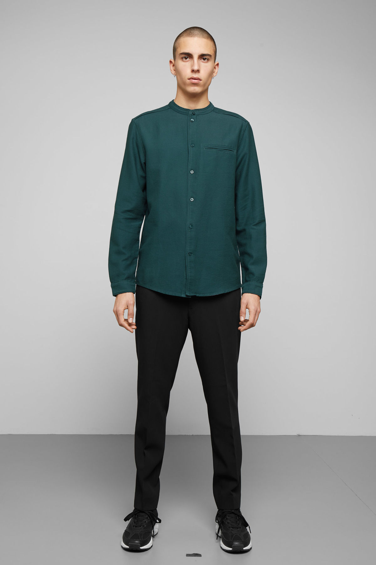 Model side image of Weekday hunt shirt in turquoise