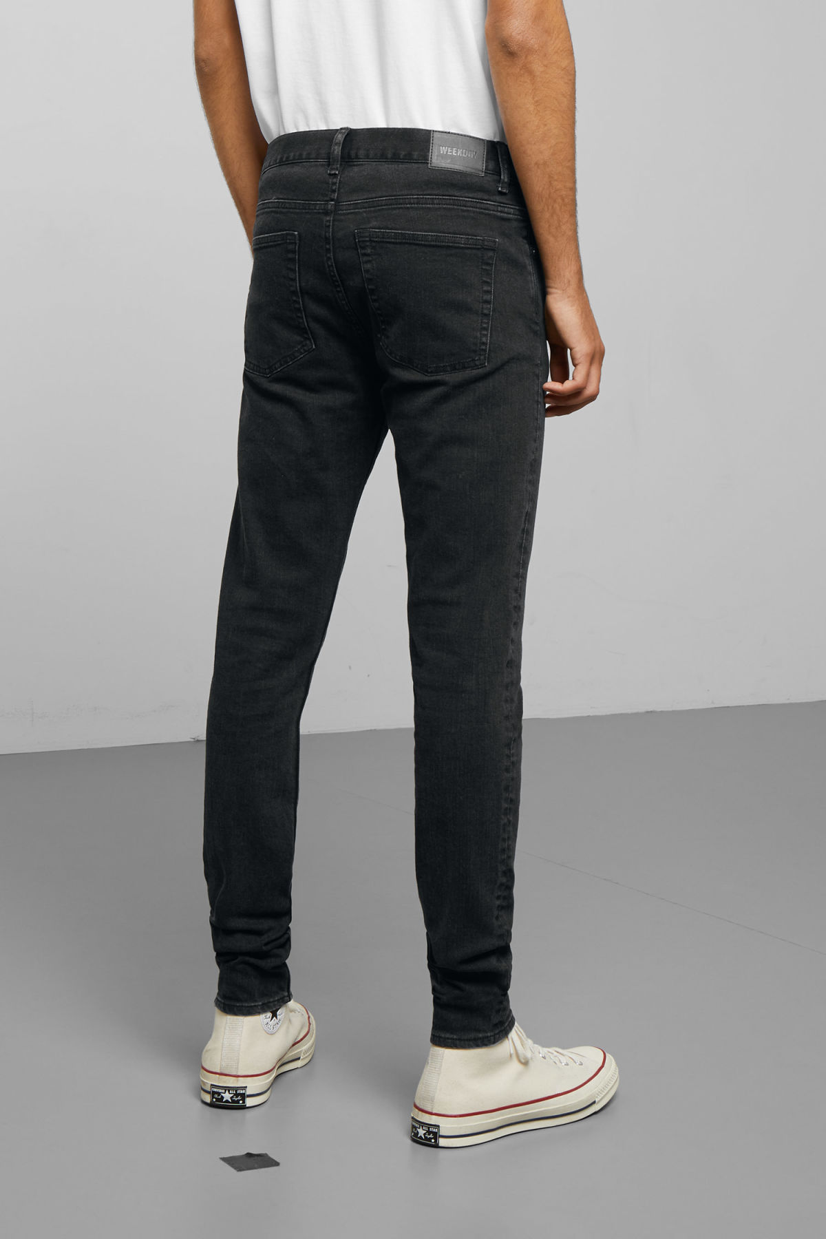 Model side image of Weekday form tuned black jeans in black