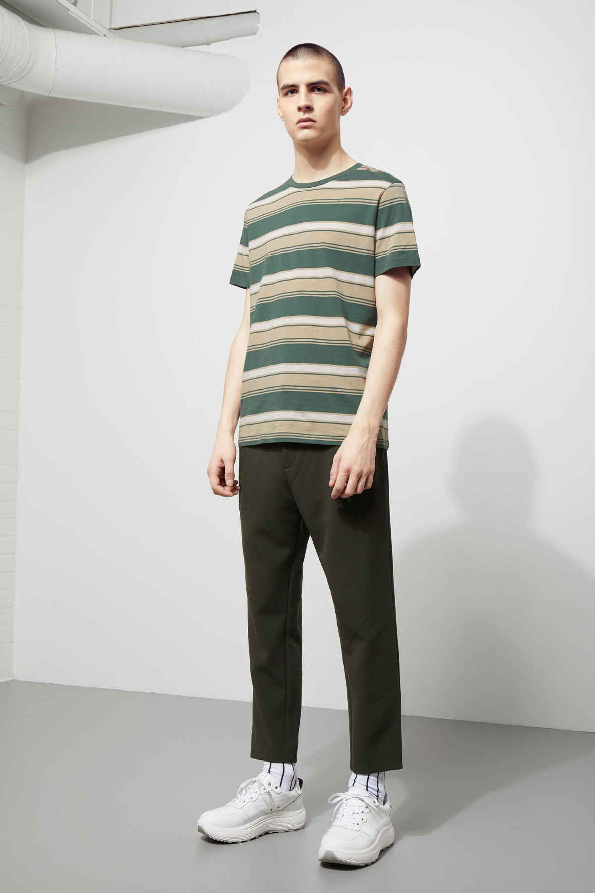 Model side image of Weekday home stripe t-shirt in green