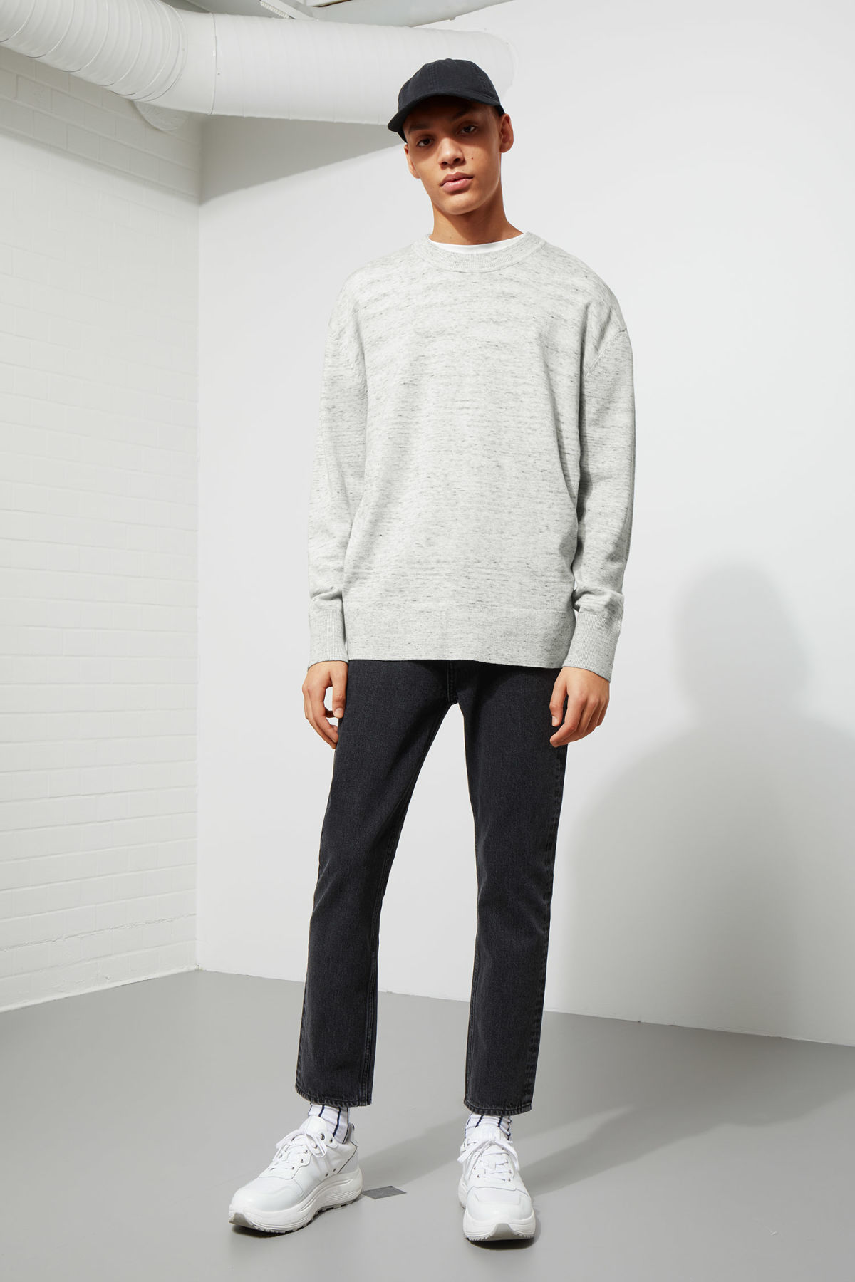 Model side image of Weekday earl cotton sweater in grey
