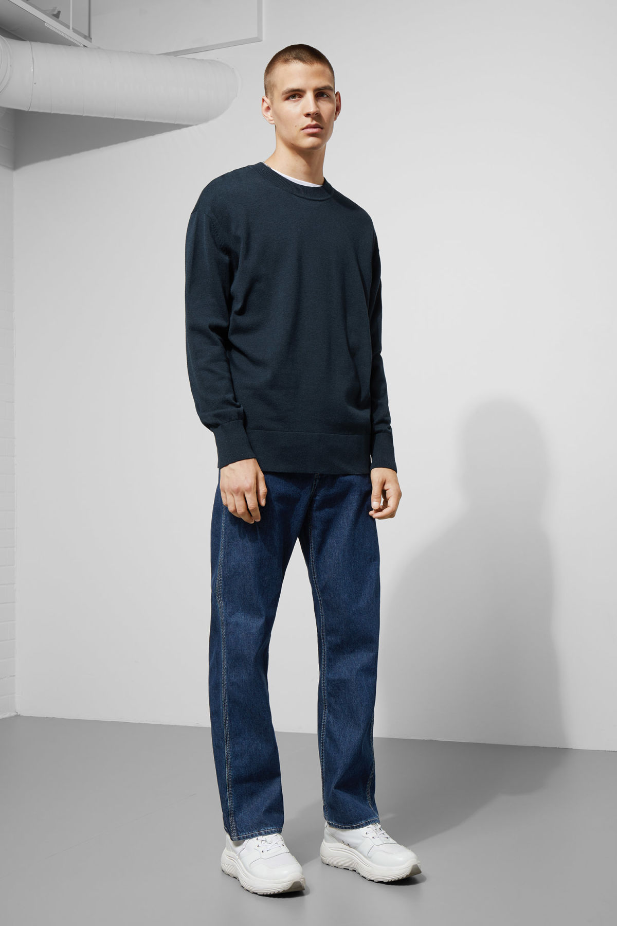 Model side image of Weekday earl cotton sweater in blue
