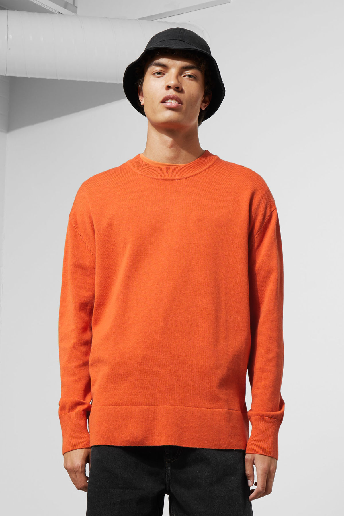 Model front image of Weekday earl cotton sweater in orange
