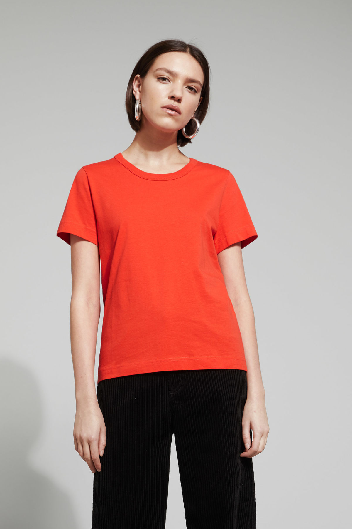Model front image of Weekday kate t-shirt in orange